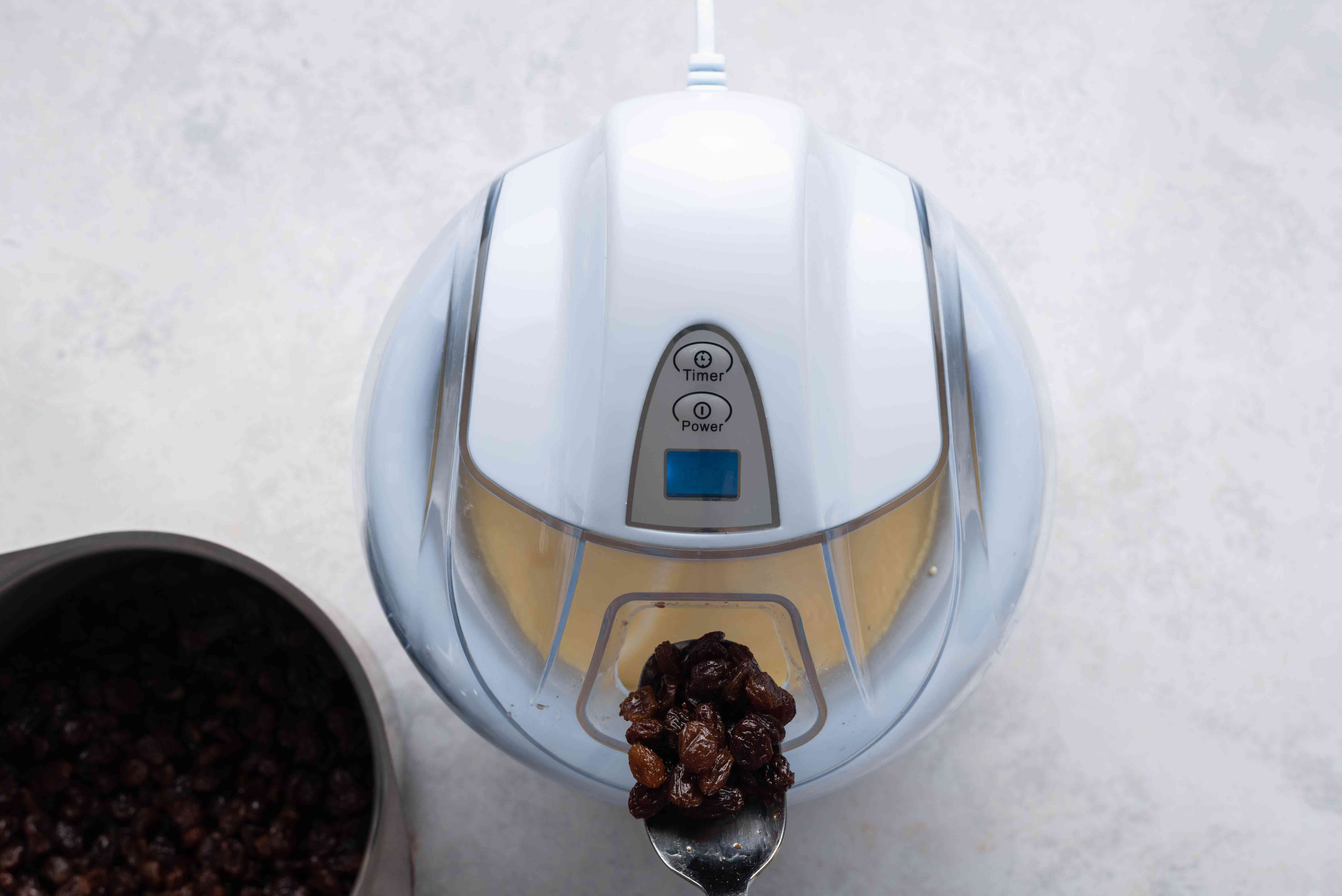 Add the soaked raisins to the ice cream maker