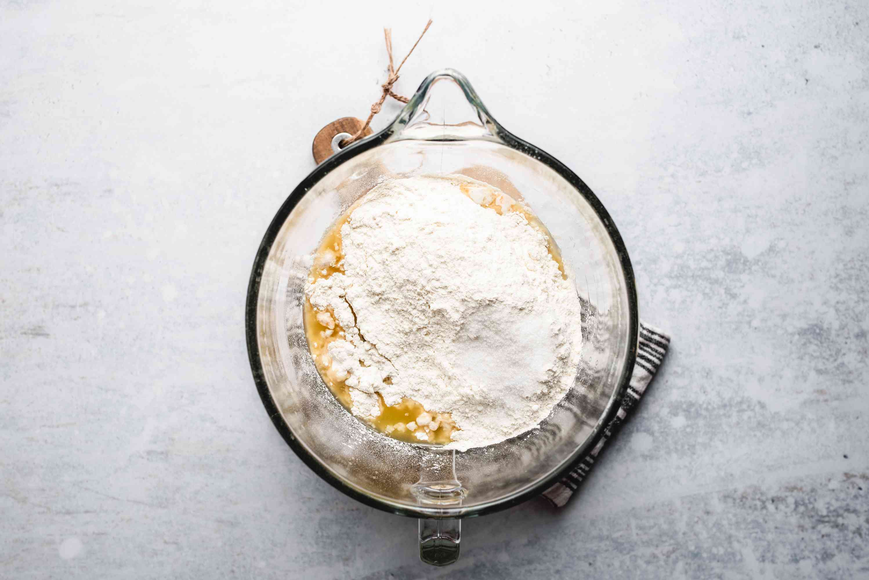 Flour, egg, butter, sugar, and salt in mixing bowl