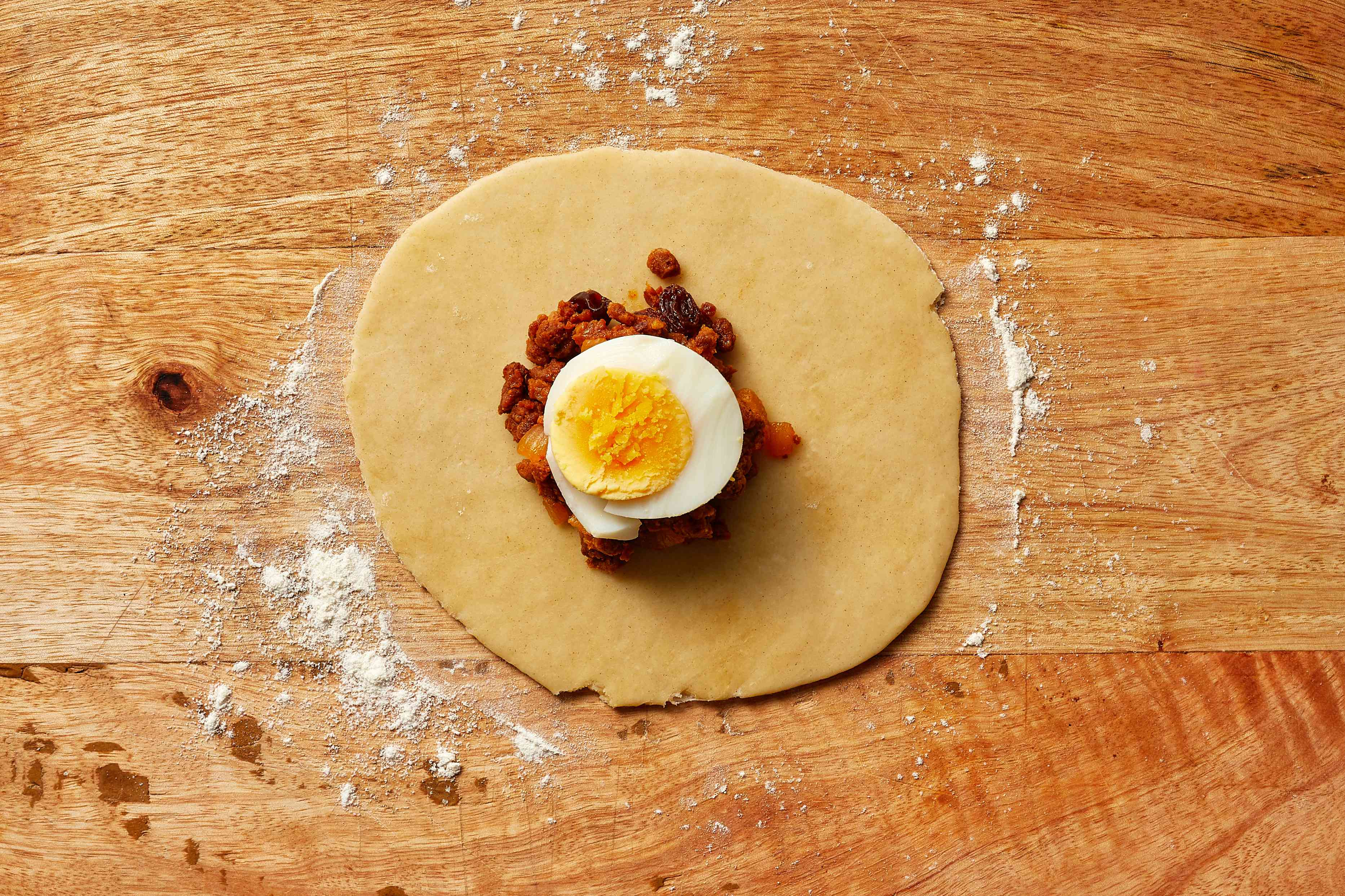 dough with meat filling and egg