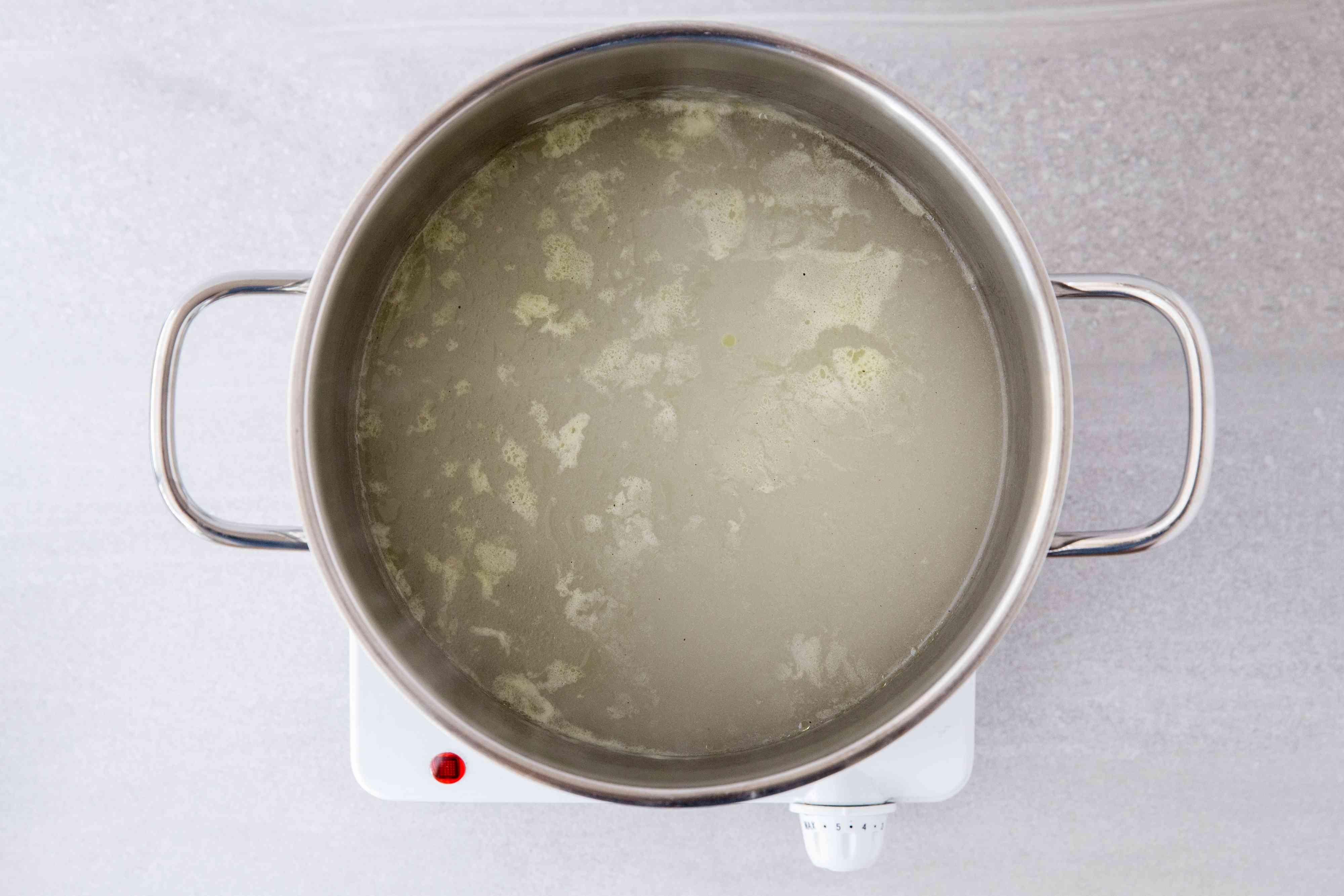 chicken broth in a pot