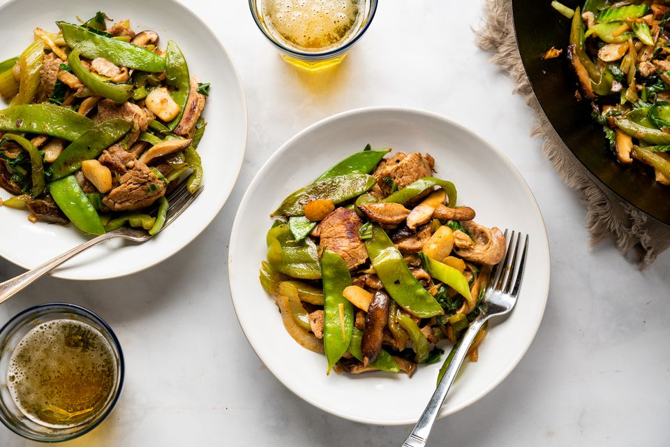Bowls of pork and vegetable chop suey
