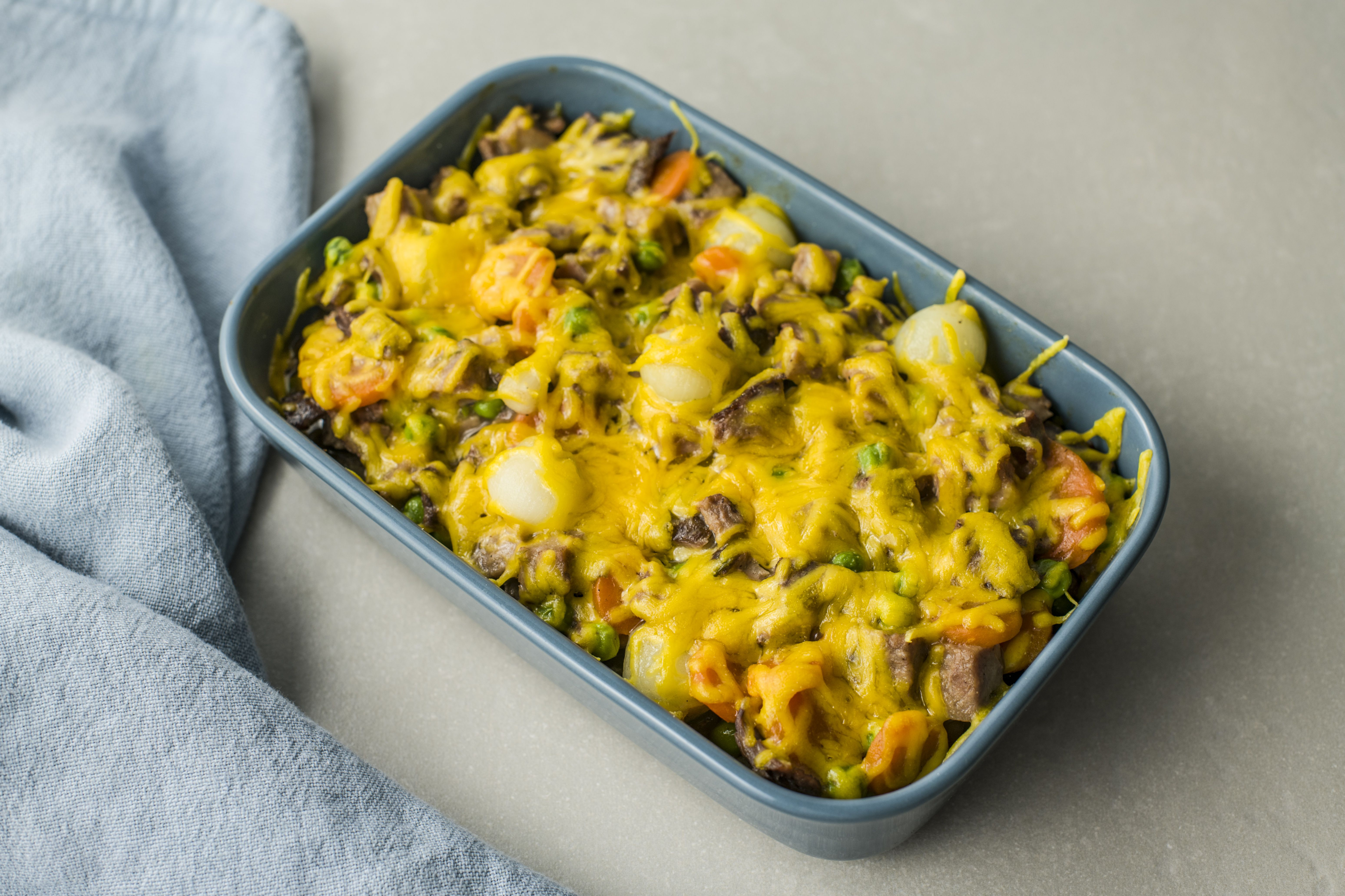 Baked roast beef casserole with vegetables and cheese