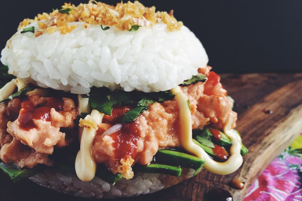 A spicy tuna and avocado sushi burger