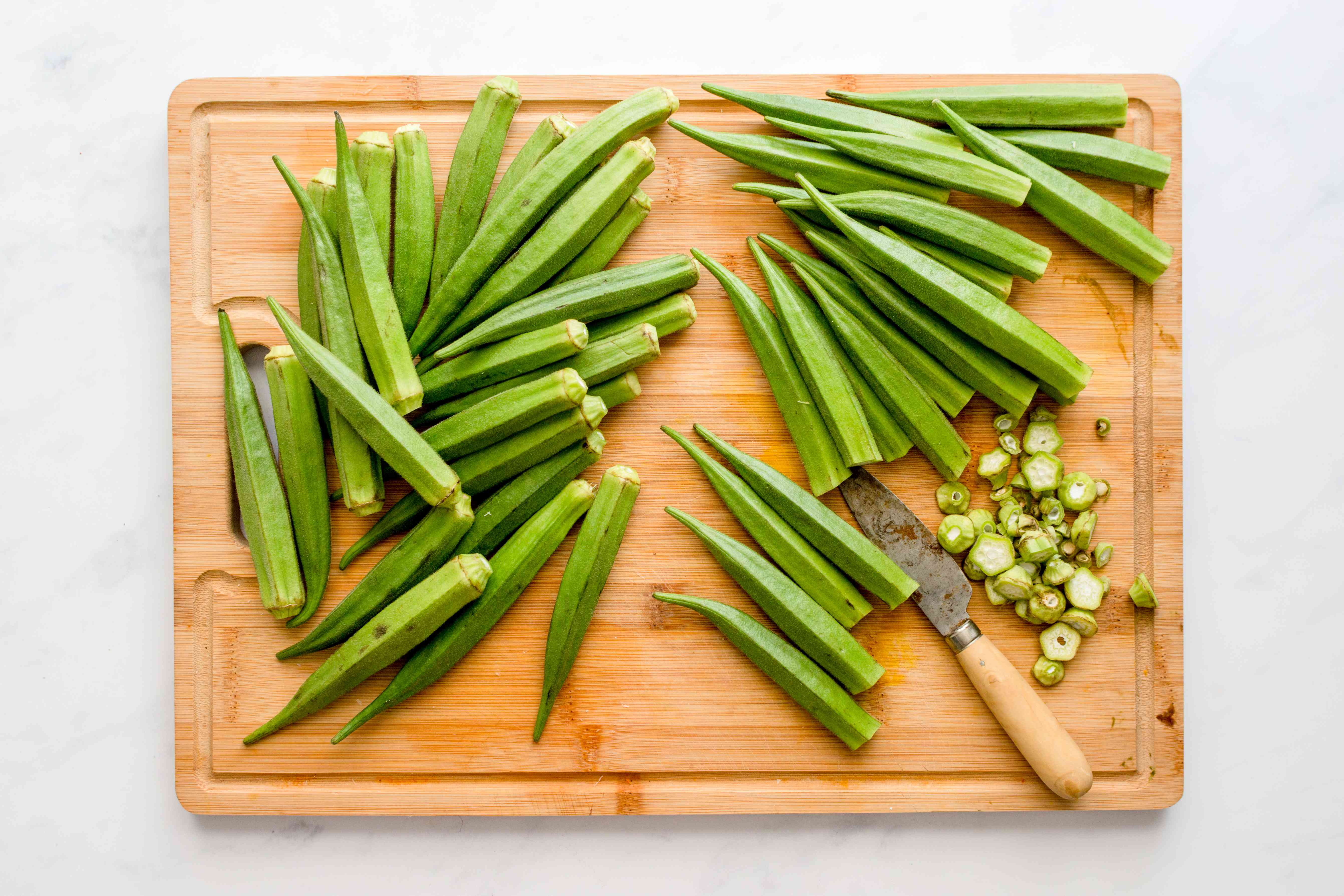 cleaned okra with the ends cut off