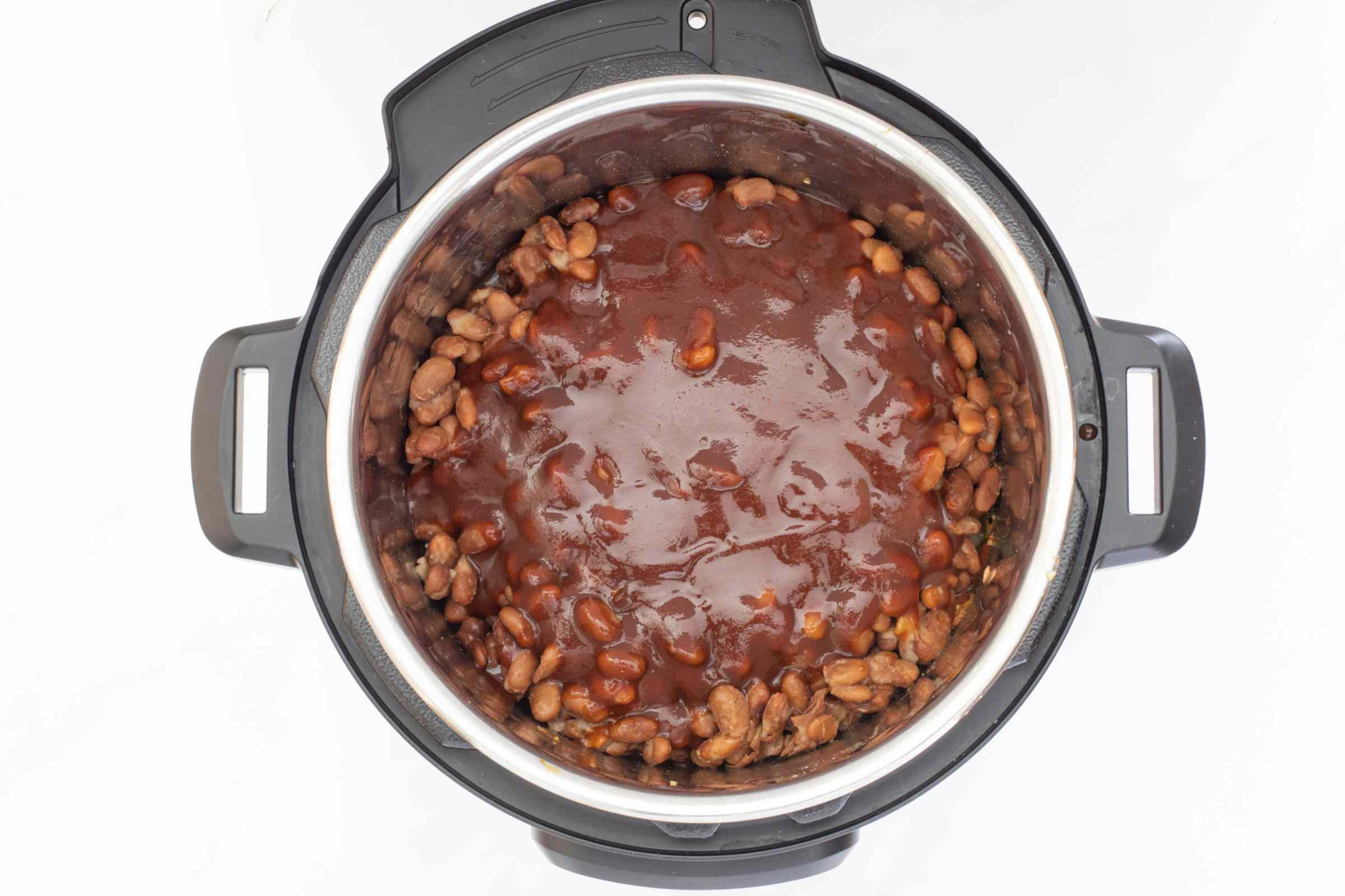 beans and barbecue sauce layered in the instant pot