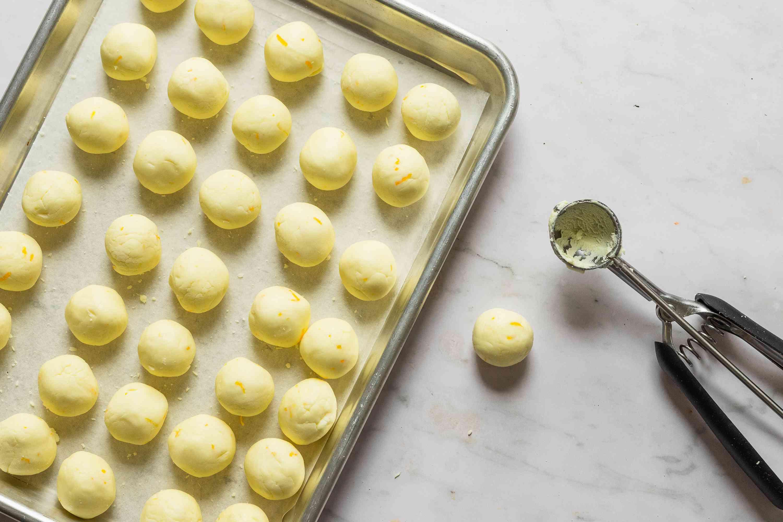lemon cream balls on a baking sheet, scoop