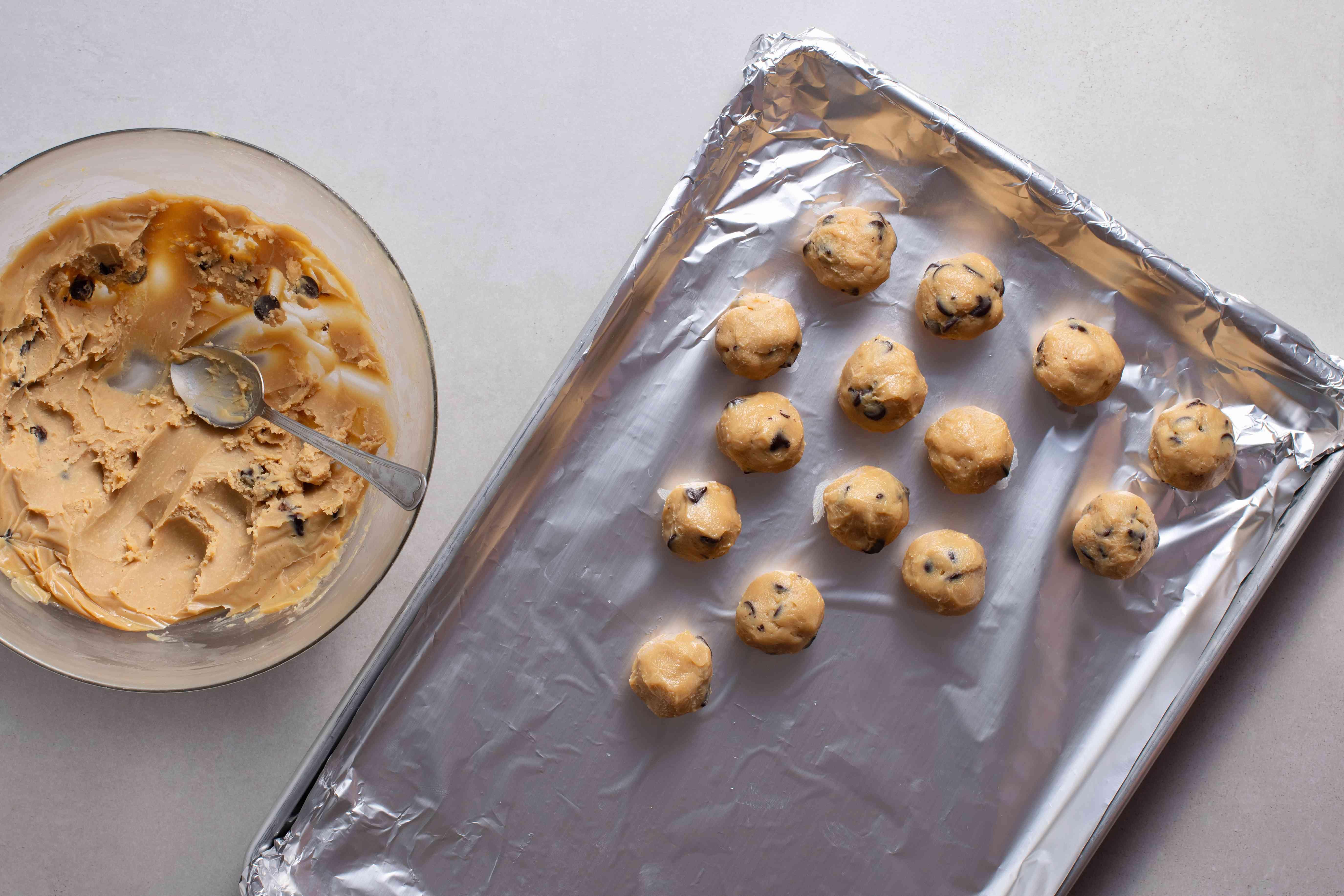 truffle balls on an aluminum foil line baking sheet