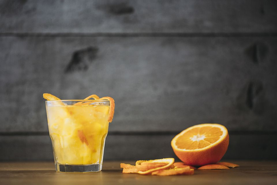 Orange juice with peeled and sliced fruit