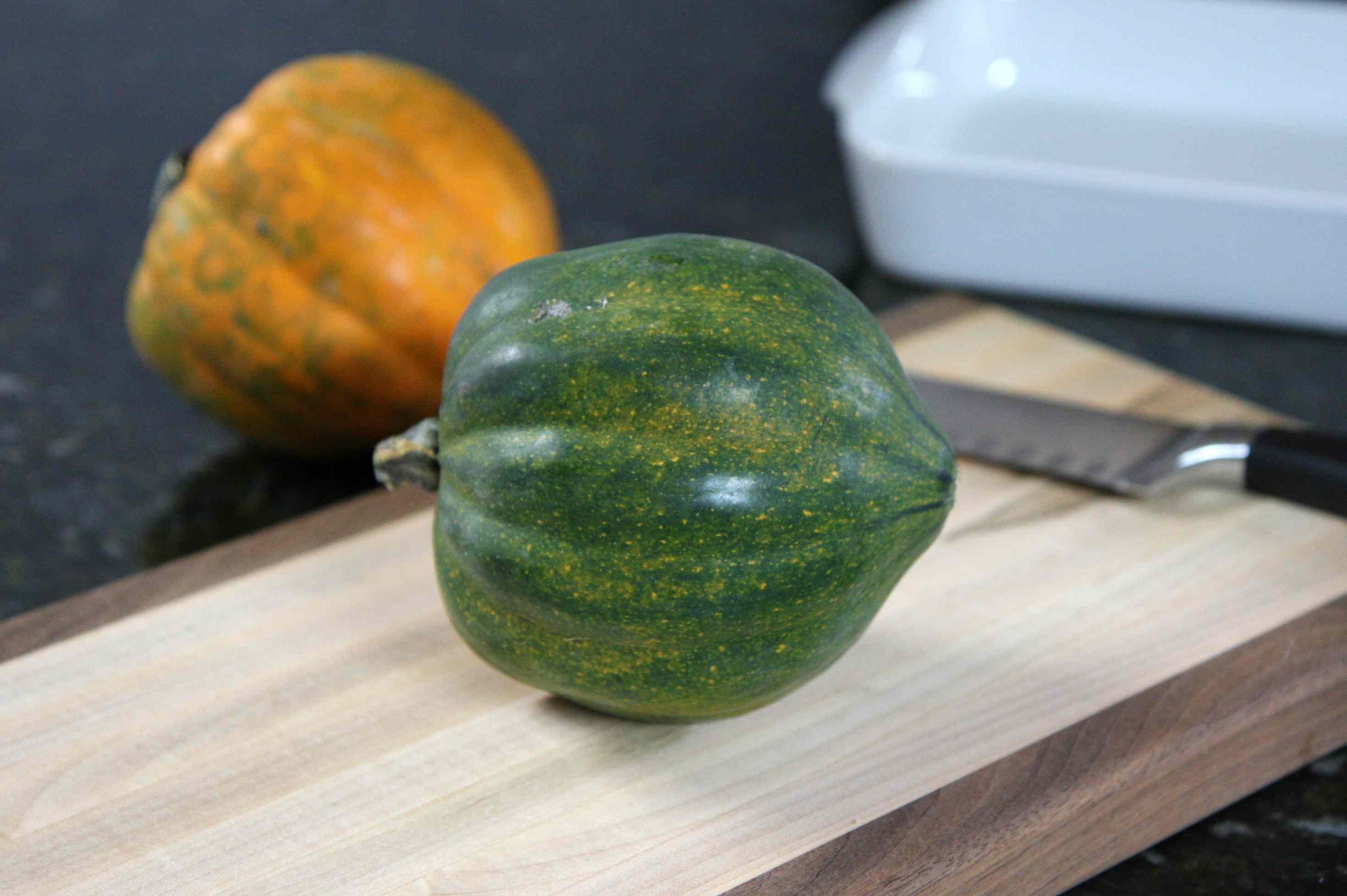 Acorn squash on a cutting board ready to be cut