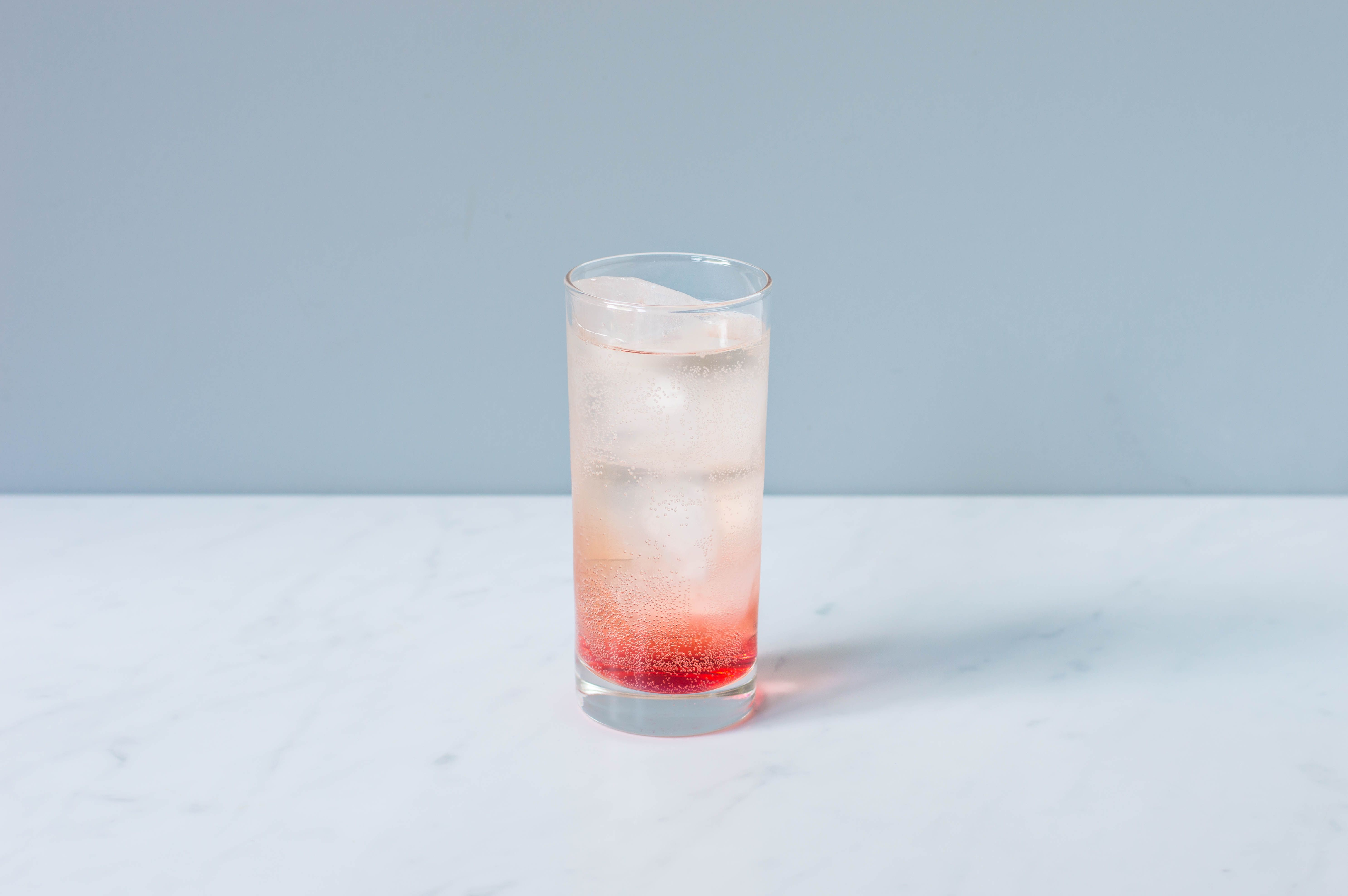 Top with equal parts lemon-lime soda and ginger ale