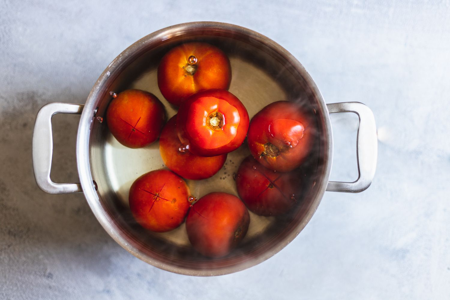 tomatoes in a large pot of water
