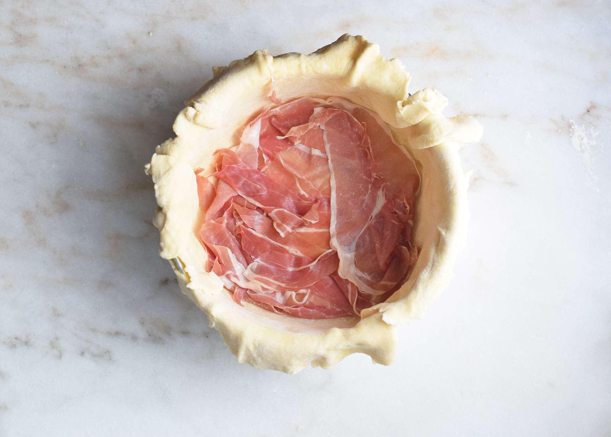 prosciutto laid into a pie crust
