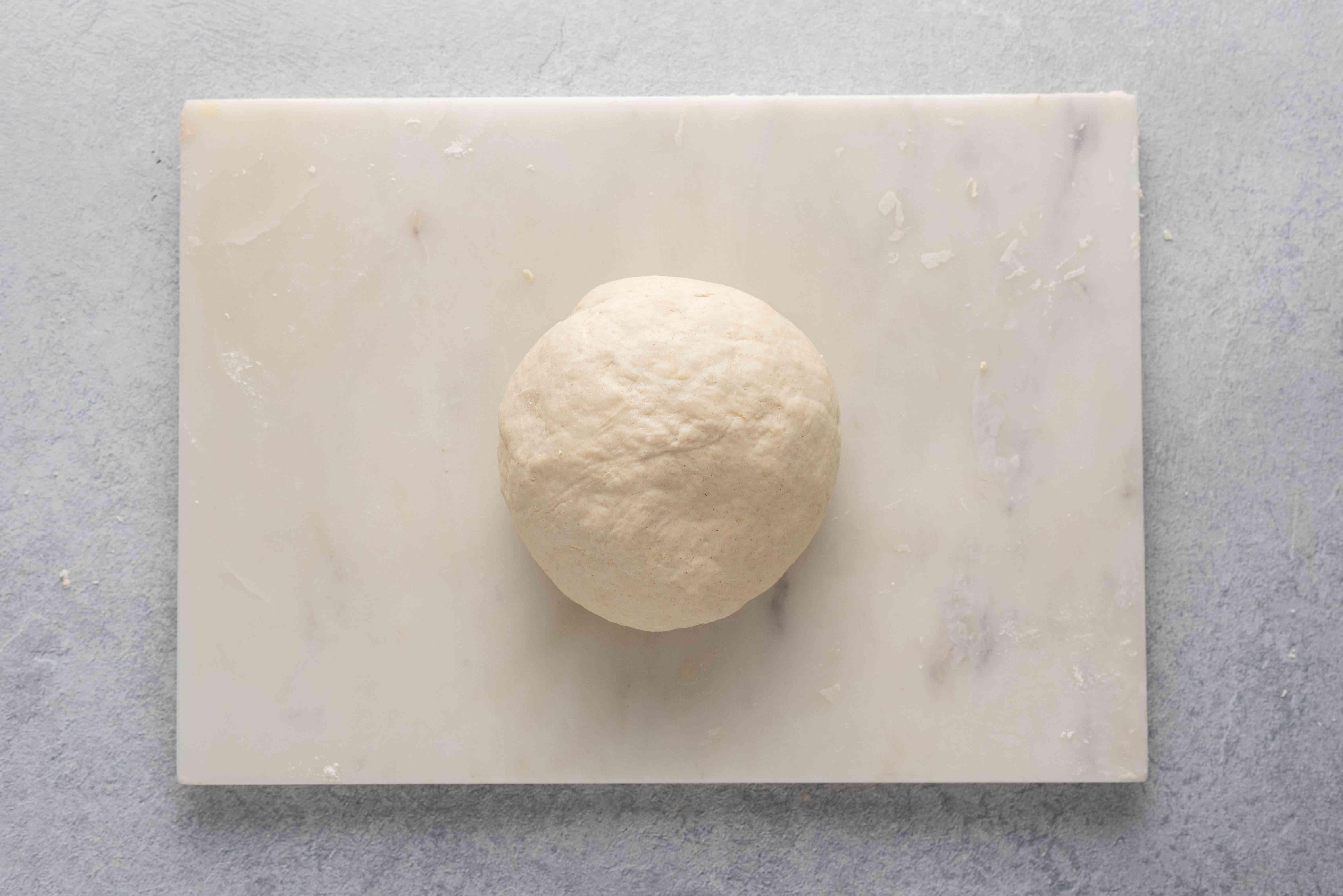 dough ball on a cutting board
