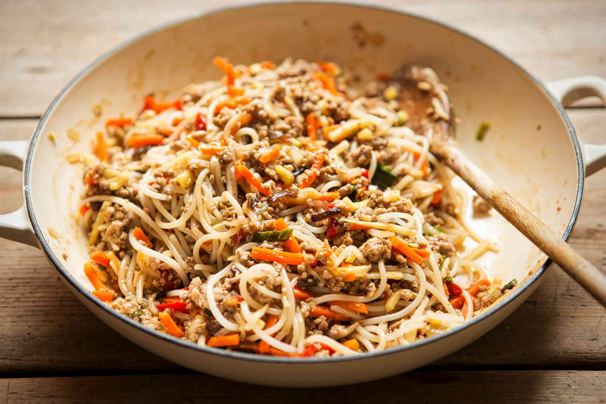 Chinese pork noodle stir fry with egg noodles and vegetables