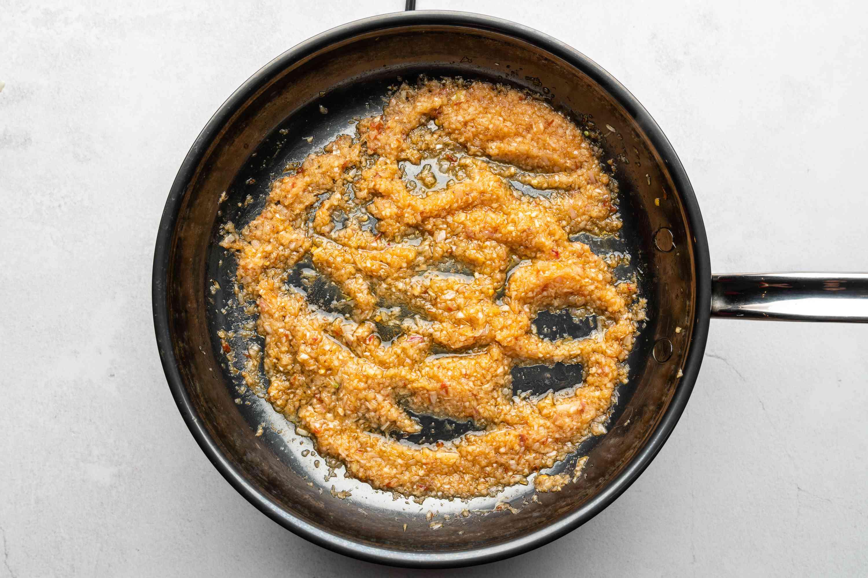 shallot-garlic-lemongrass paste, sambal oelek, tamarind paste, sugar, ginger, shrimp paste, and fish sauce in a pan