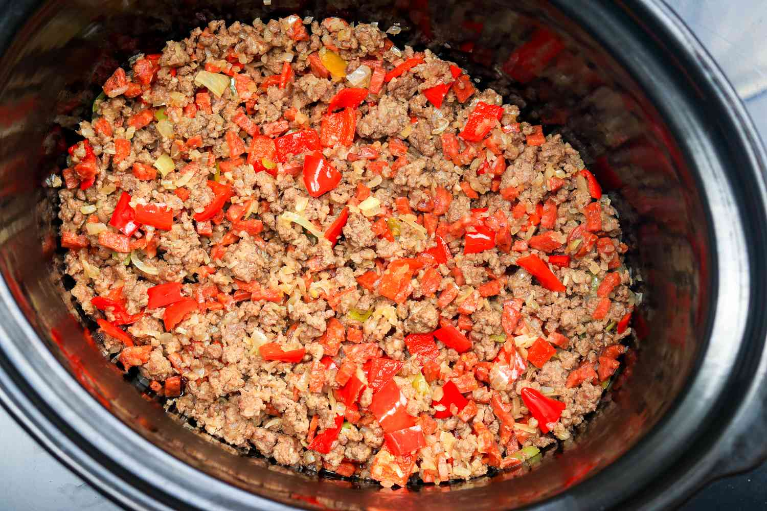 Chili With Ground Beef and Sausage mixture in a crock pot