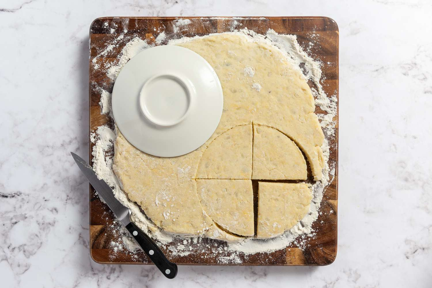 Dough with circles cut out, cut into wedges