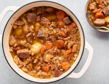 Traditional Welsh cawl stew in a Dutch oven