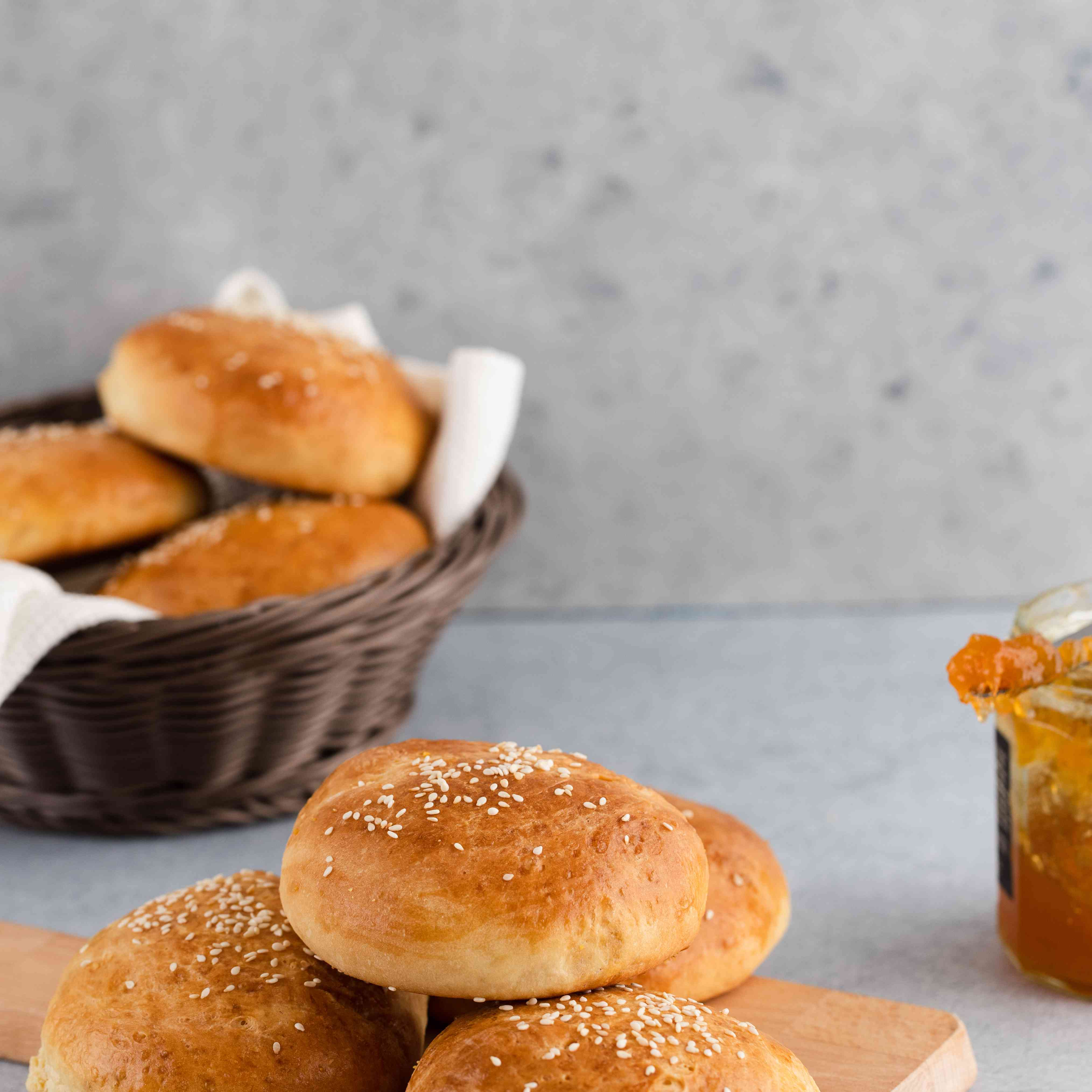 Rich homemade brioche buns on a cutting board