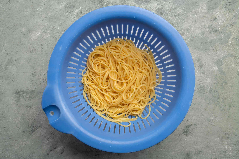 spaghetti in a colander