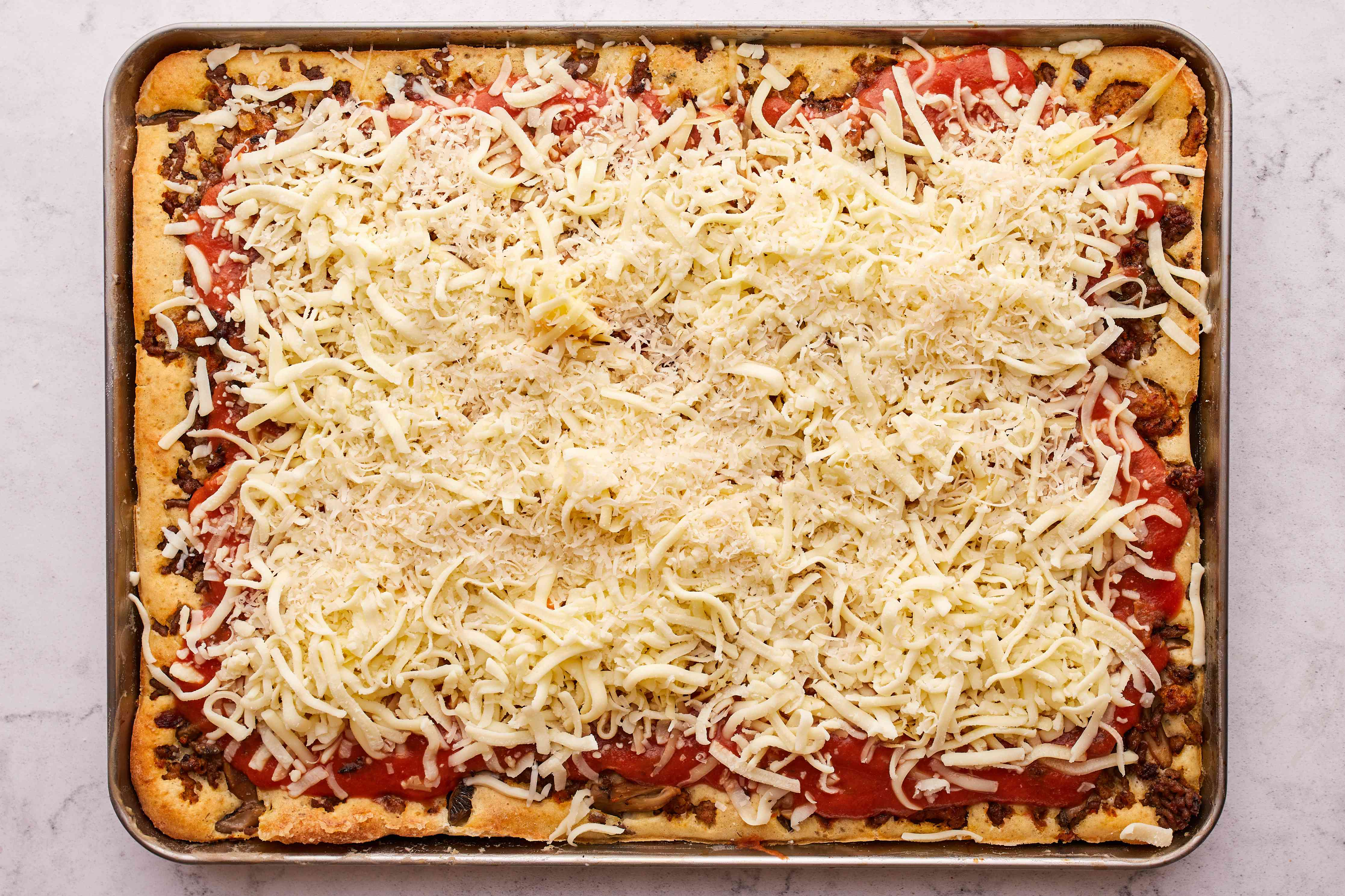 Crazy Crust Pizza, sauce an cheese on top