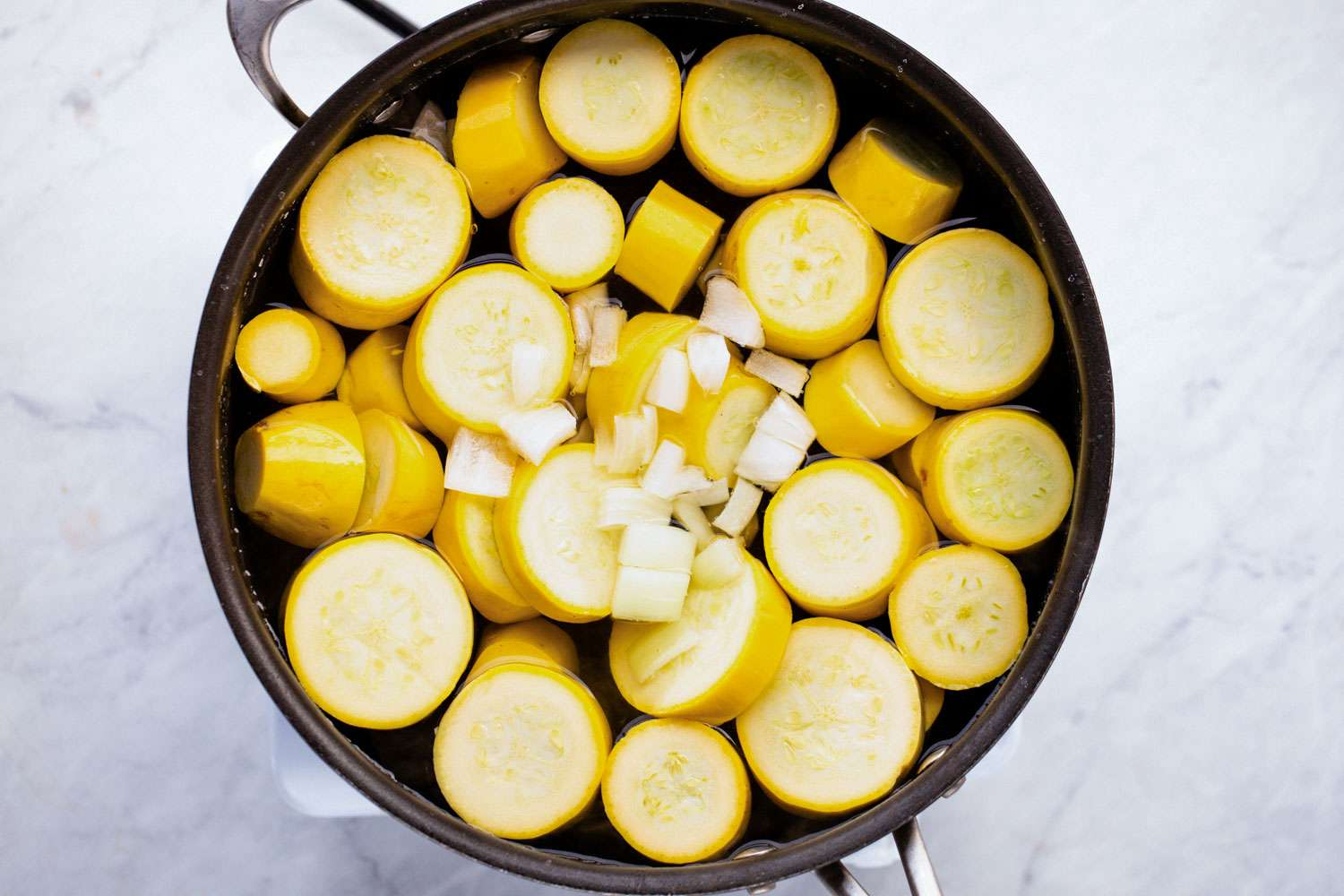 Cook the sliced squash and chopped onion in boiling salt water