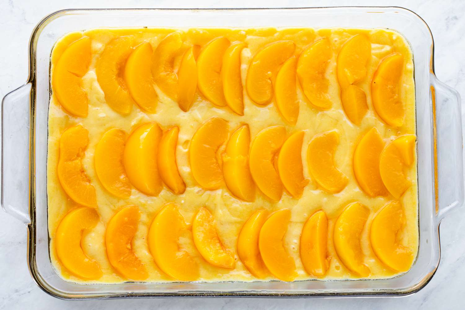 Layer drained peaches on top of the batter
