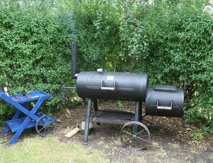 An outdoor BBQ smoker