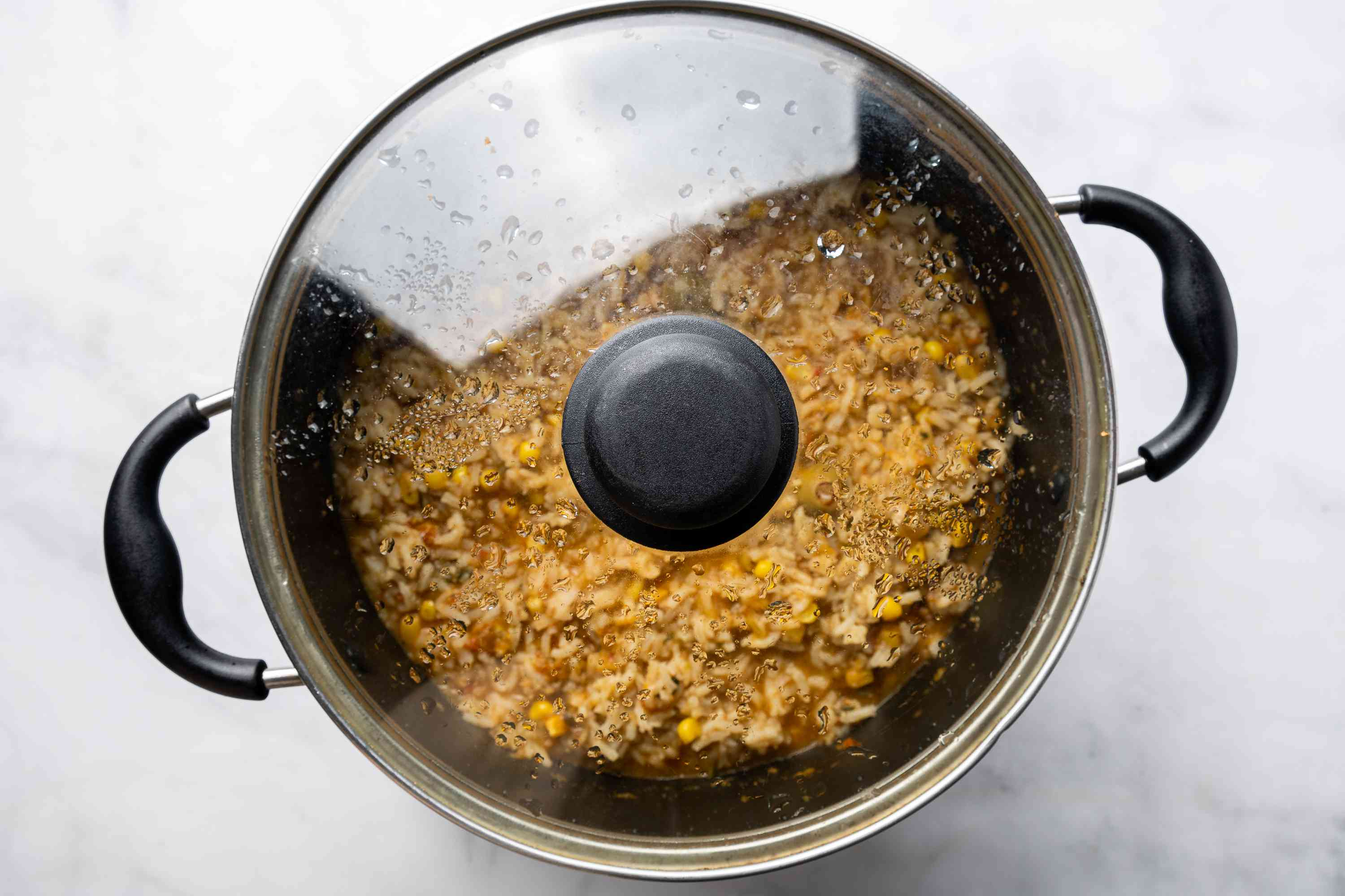 rice in pot, with lid on, off of heat on counter