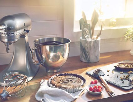 Kitchen Aid mixer and a chocolate tart