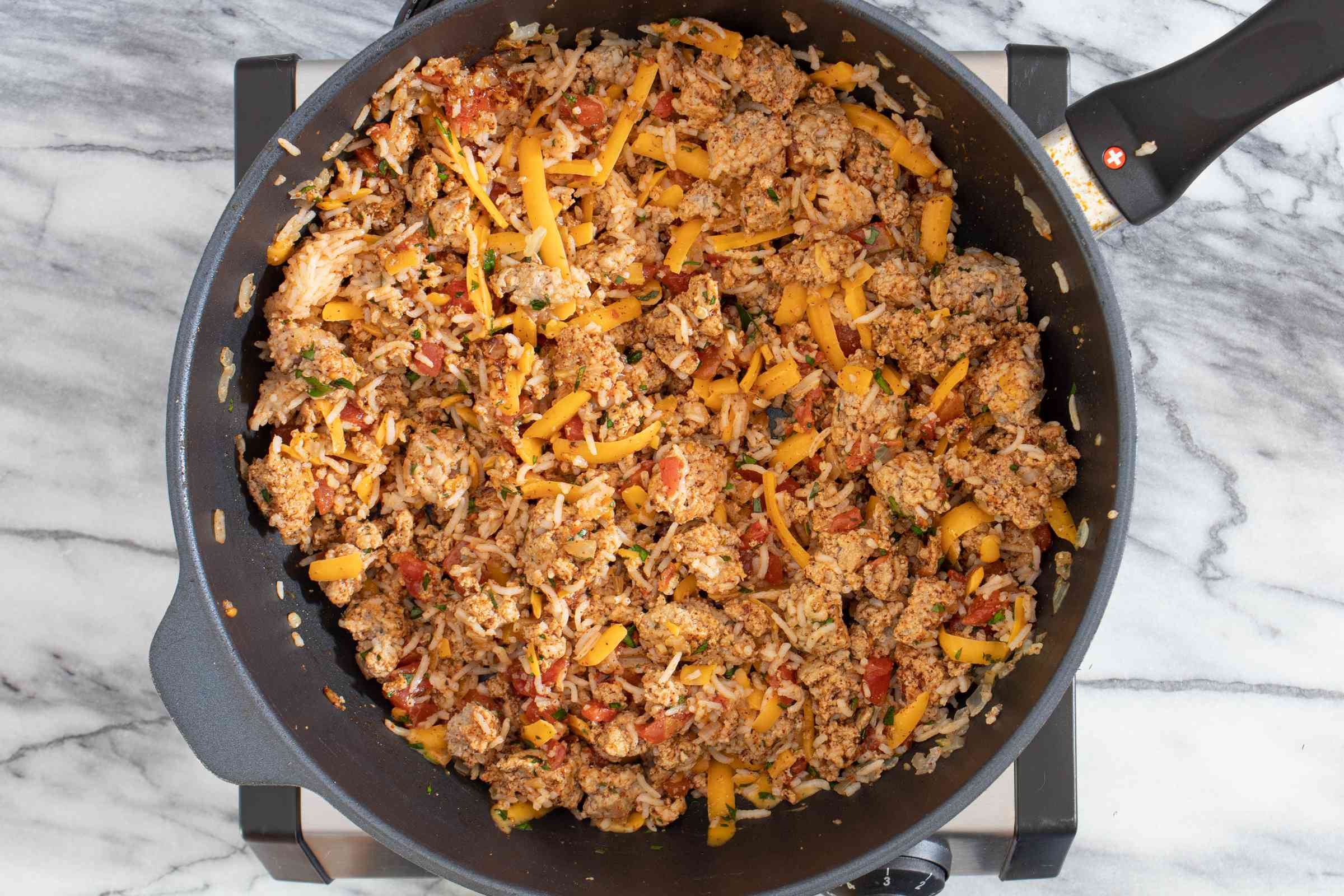 skillet with turkey stuffing for stuffed peppers