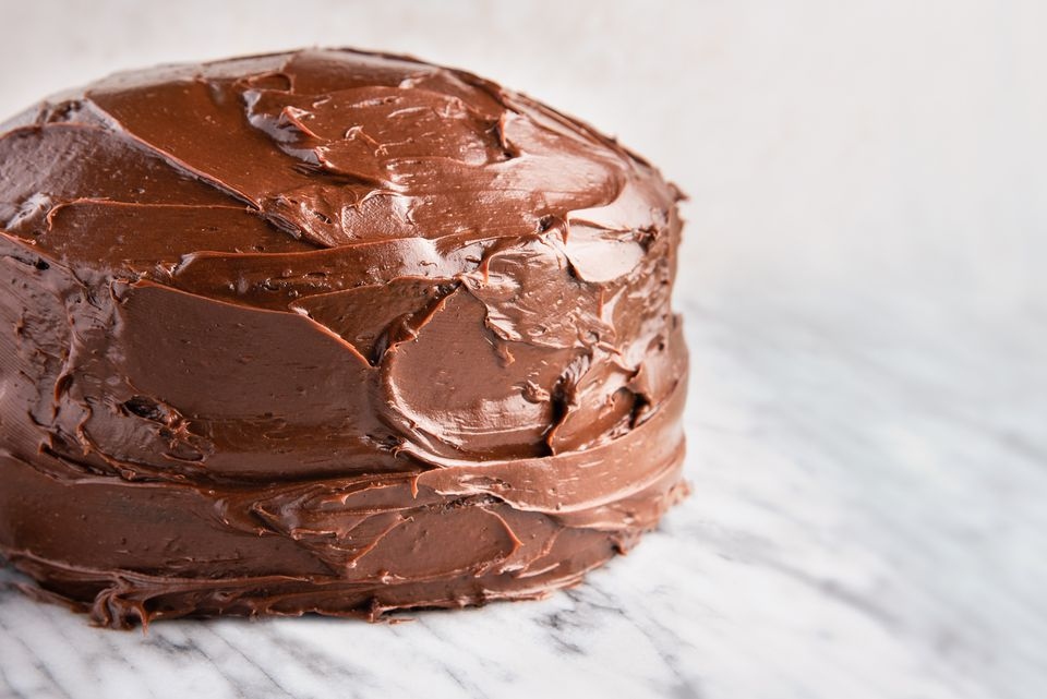 Add frosting to chocolate cakes