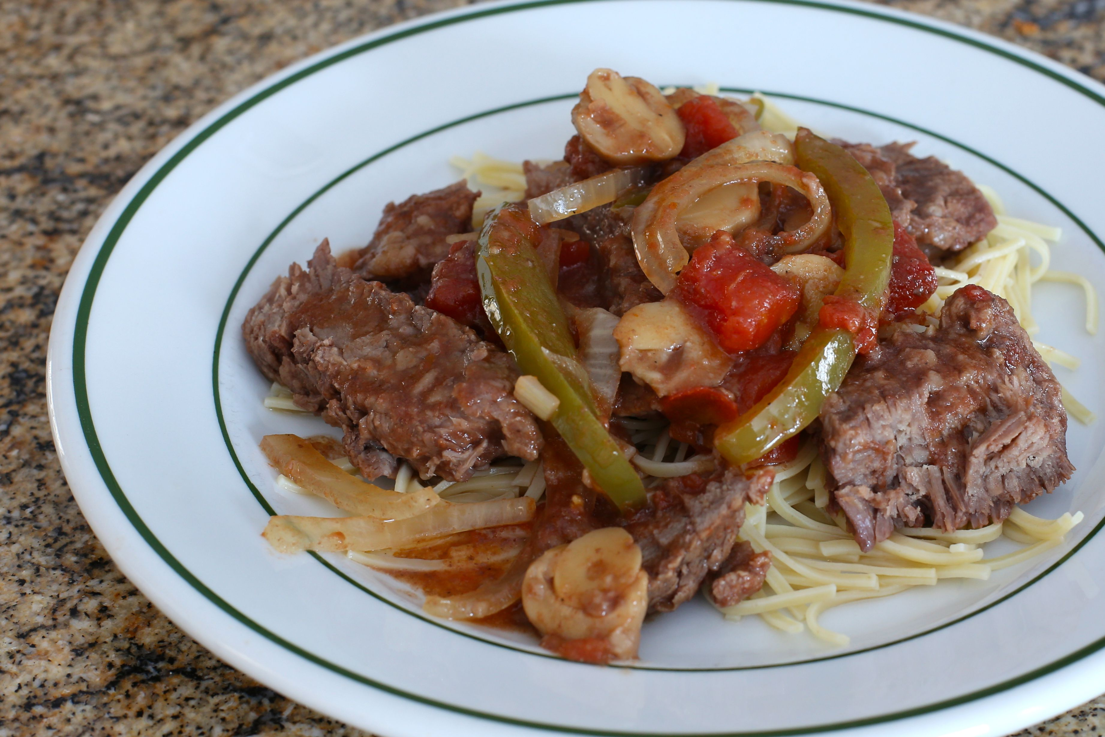 Smothered steak with peppers, slow cooker.