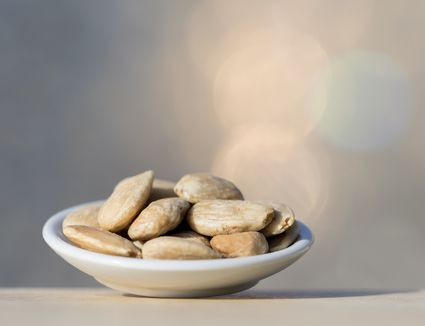 Plate of fried peeled almonds