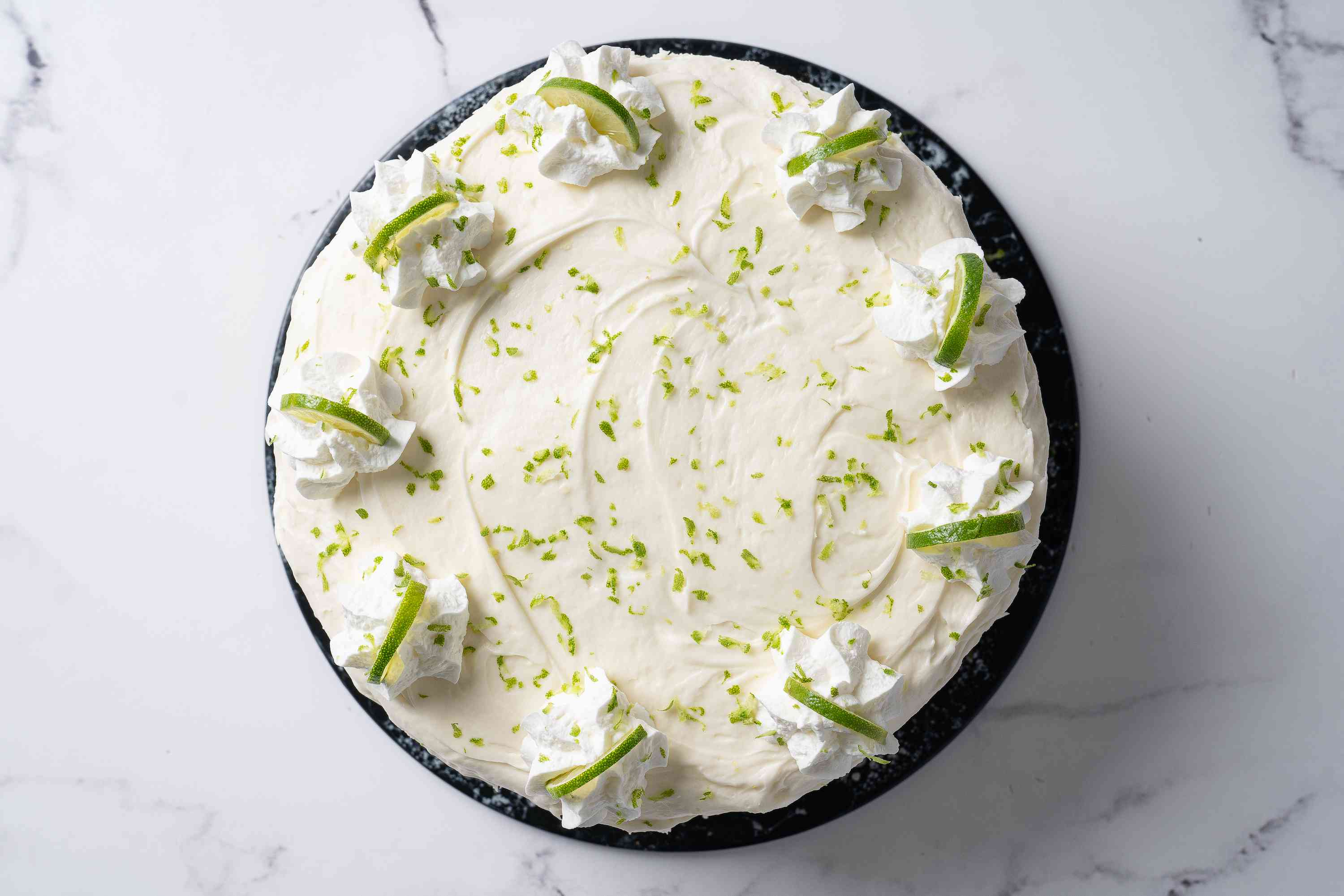 Garnish Key Lime Cake with zest and slices