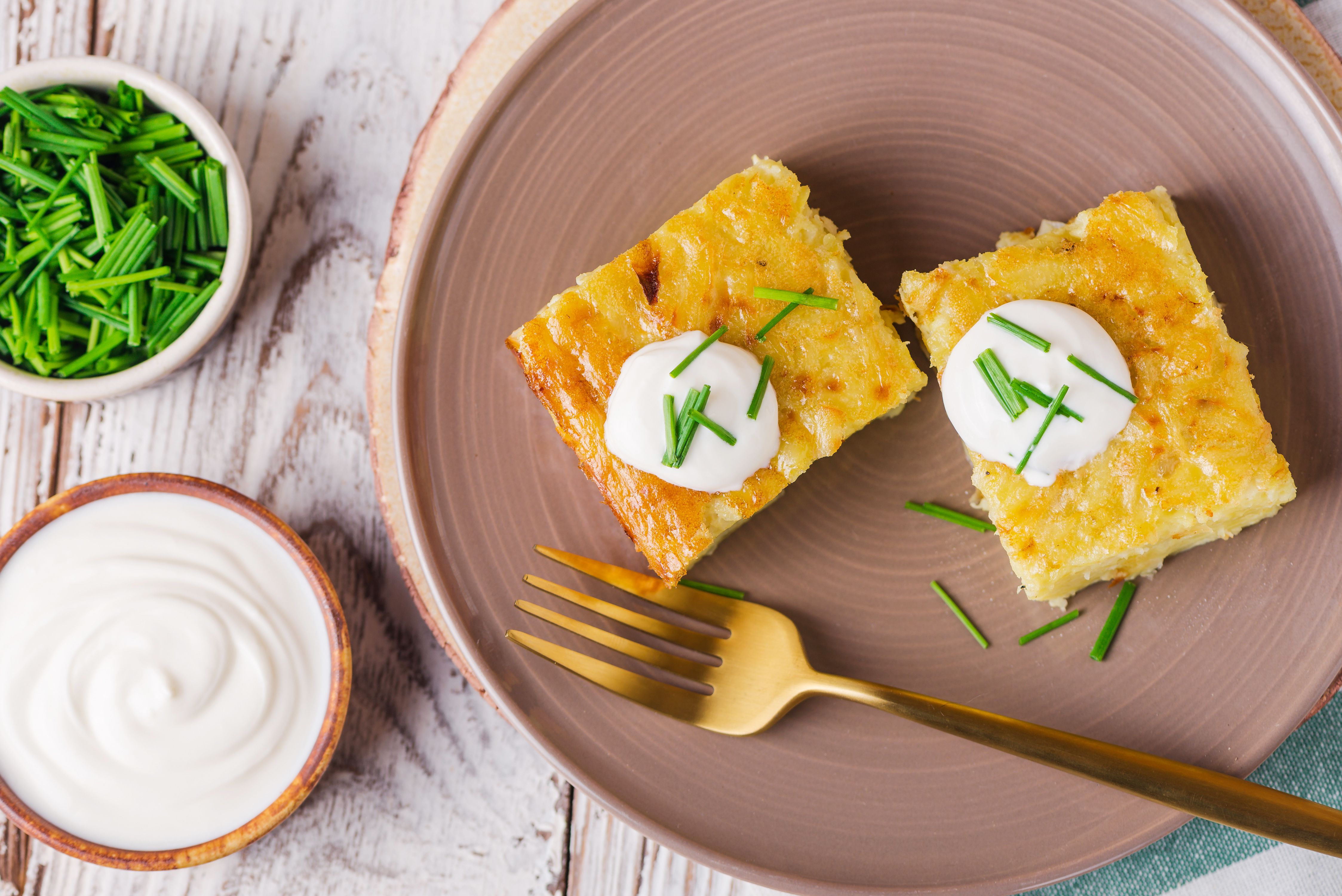 Serve kugel with sour cream and chives