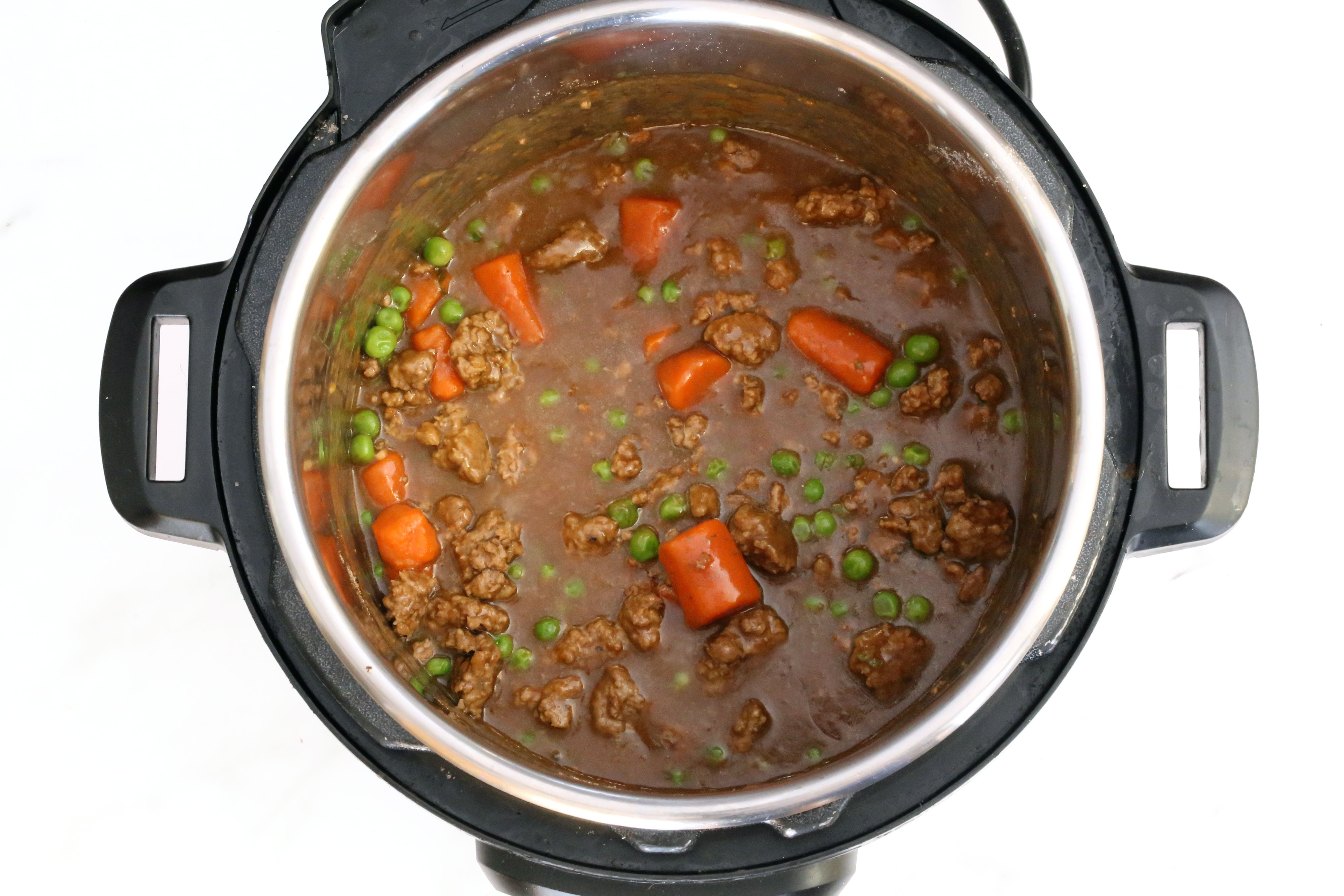 Add the gravy mix to the Instant Pot pressure cooker