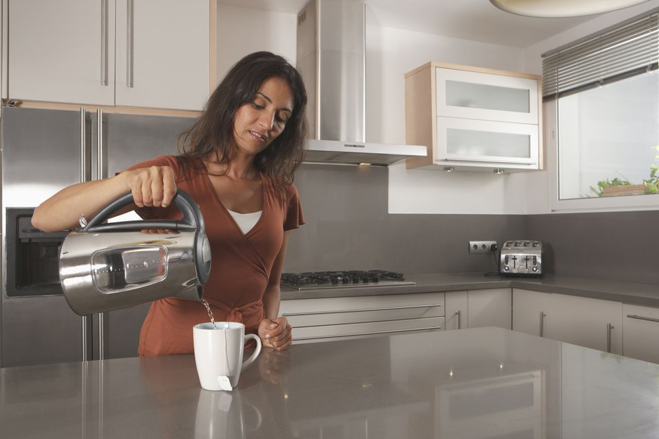 woman using kettle
