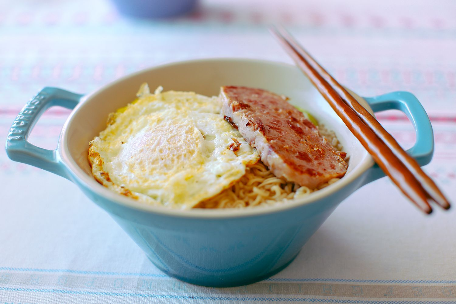 noodles with lunch meat and over-easy egg