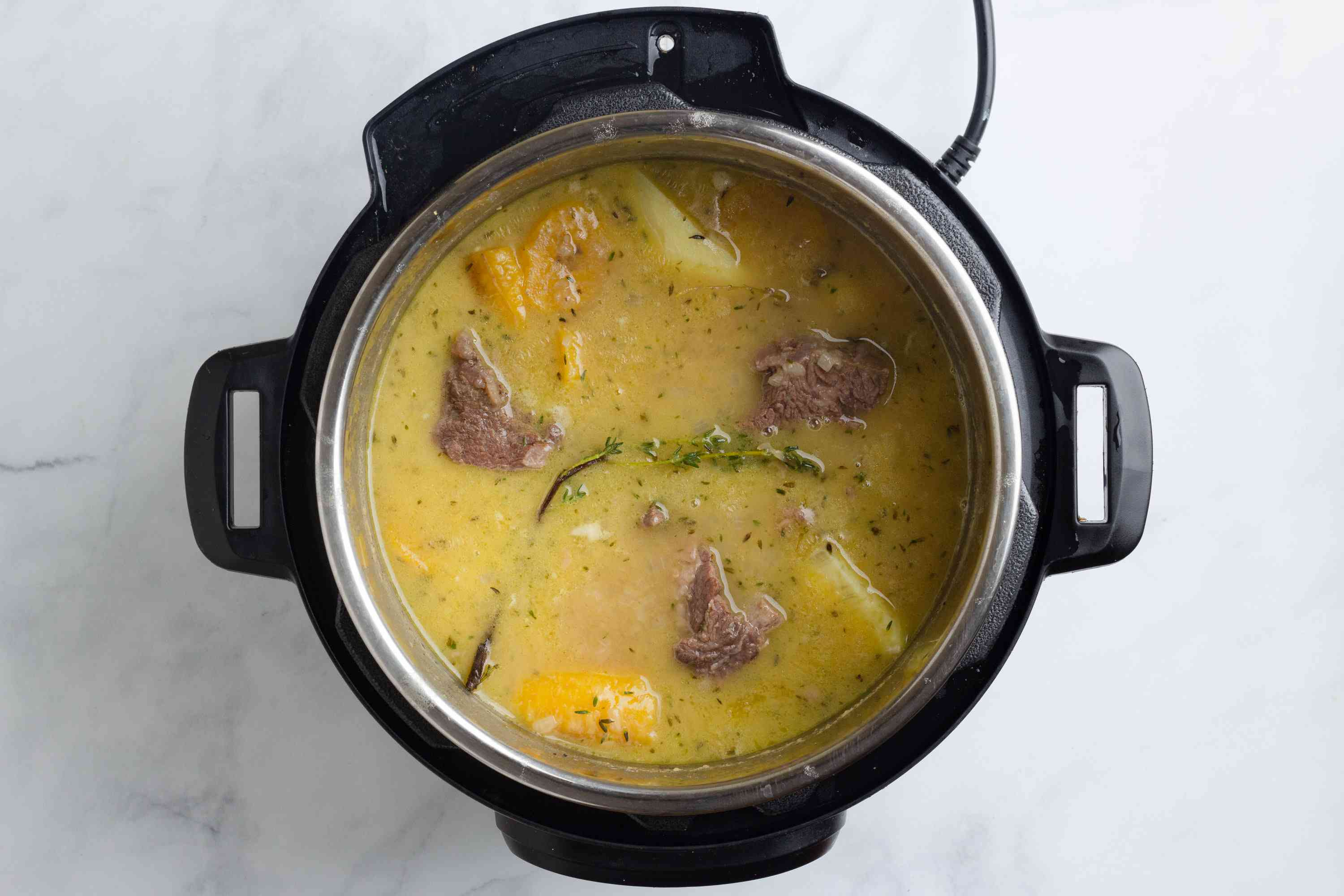 Caribbean Beef Soup cooking in a pressure cooker