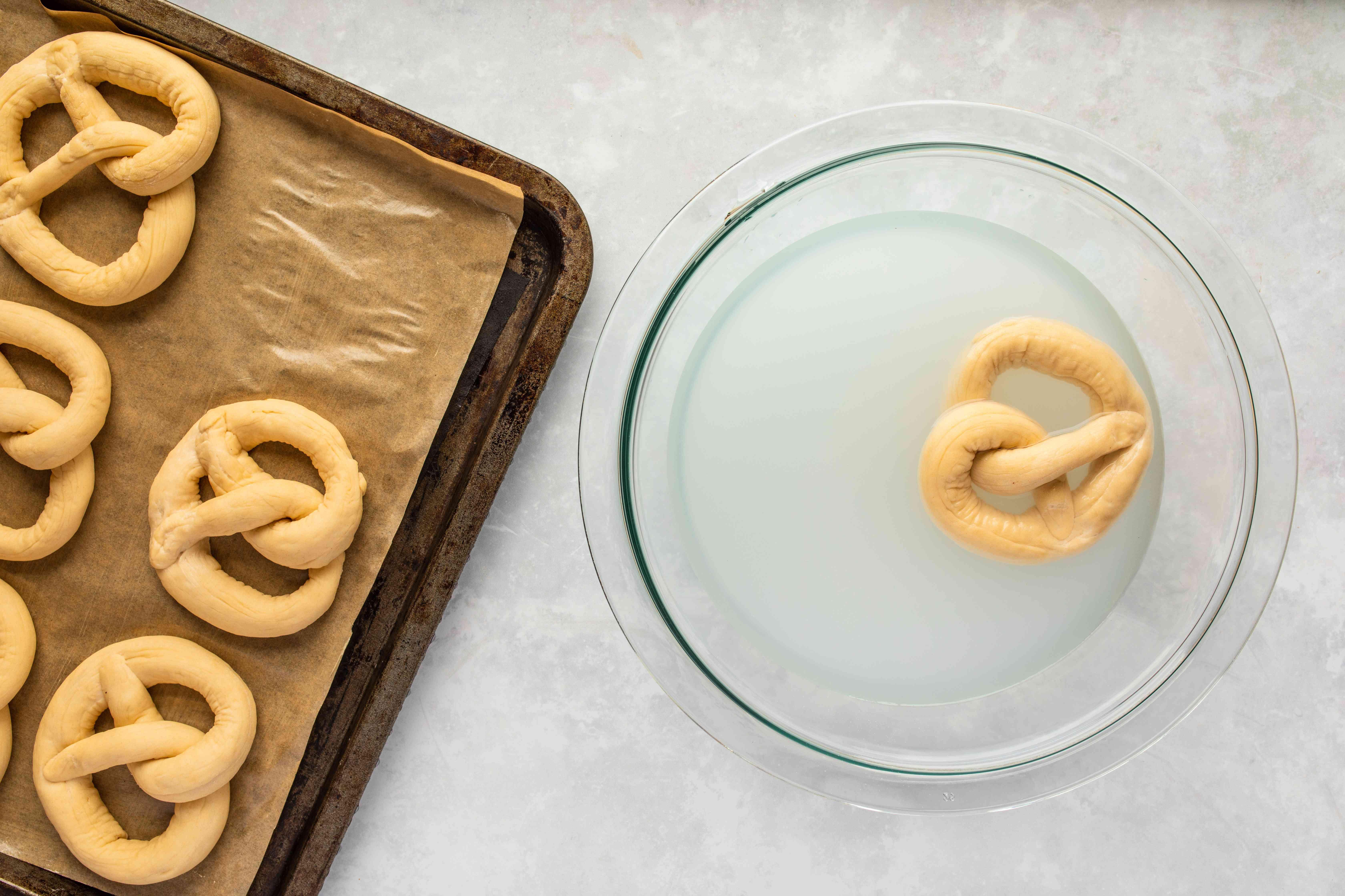 Dip each pretzel in lye