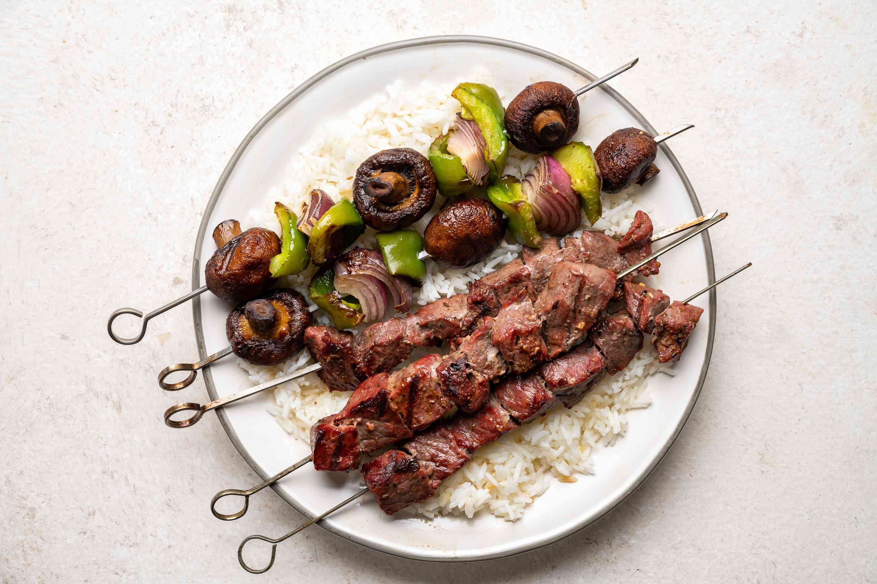 Middle Eastern Beef Shish Kebabs served on rice