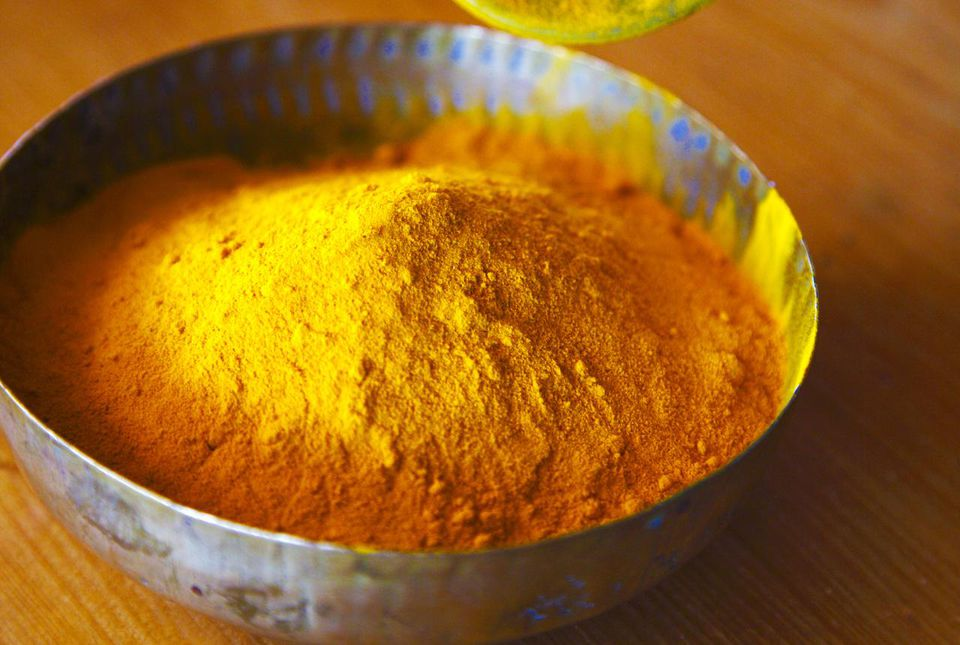 Tumeric spice measured into a bowl