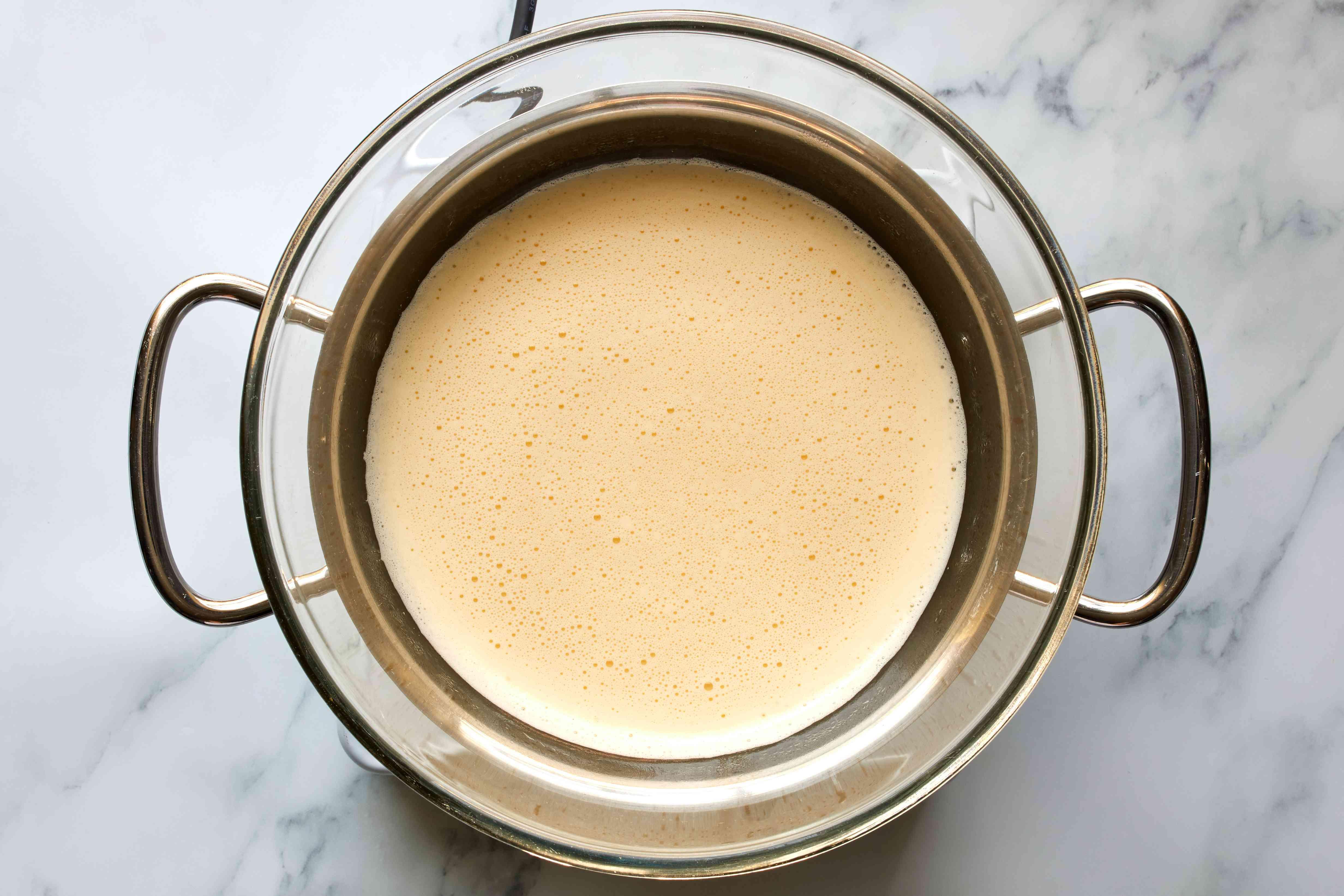 egg mixture into the top of a double-boiler