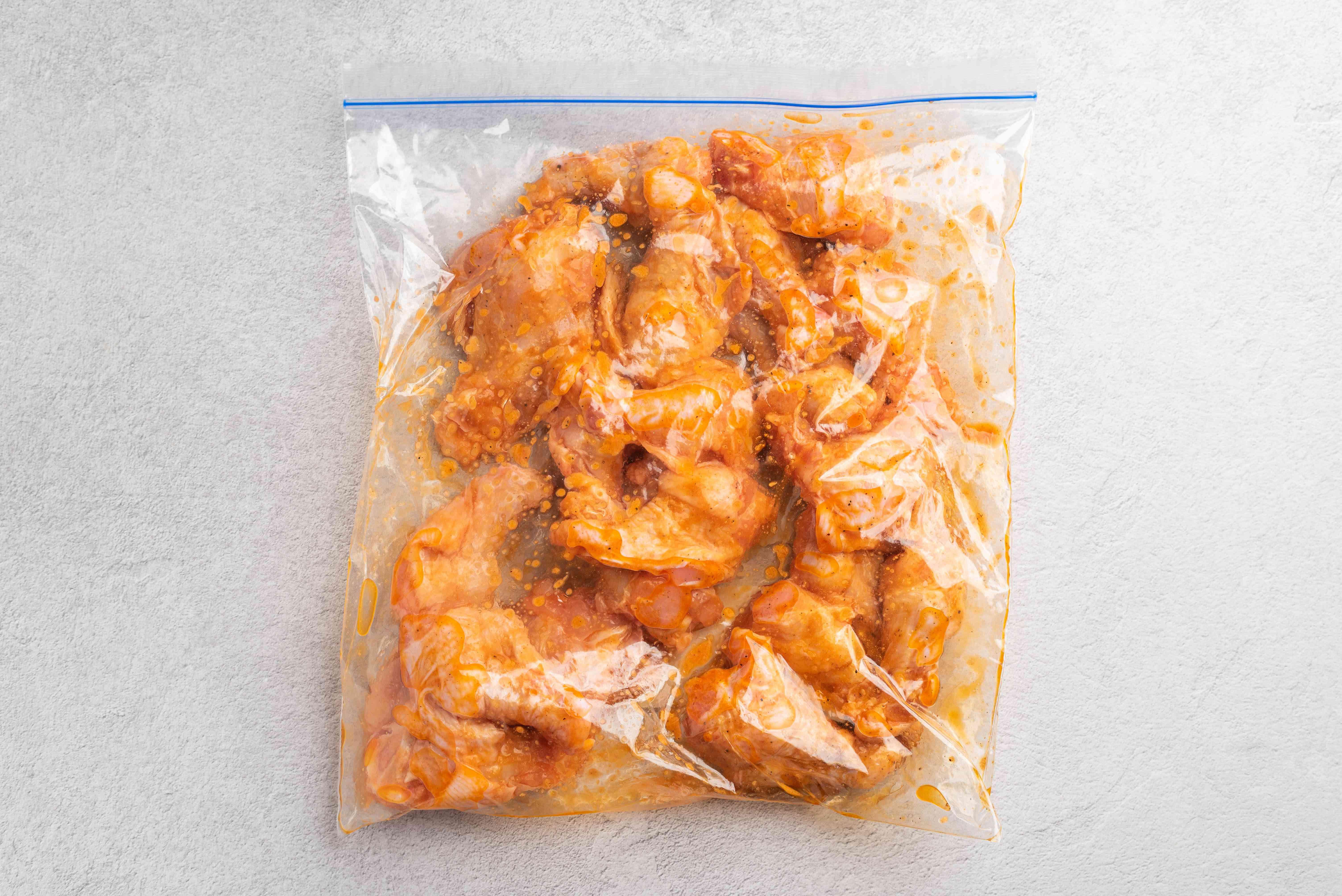 Chicken drumettes with marinade in zip-top bag
