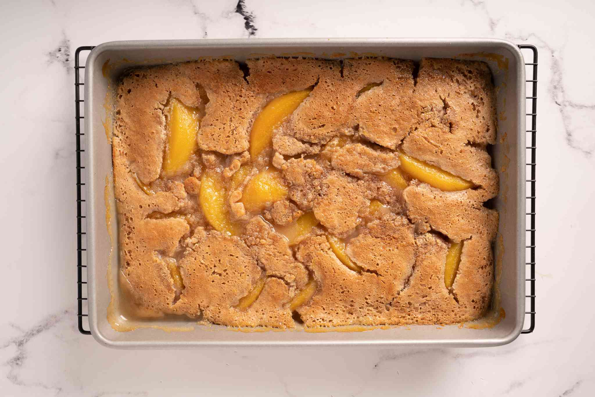 Everyone's Favorite Shortcut Peach Cobbler in a baking dish