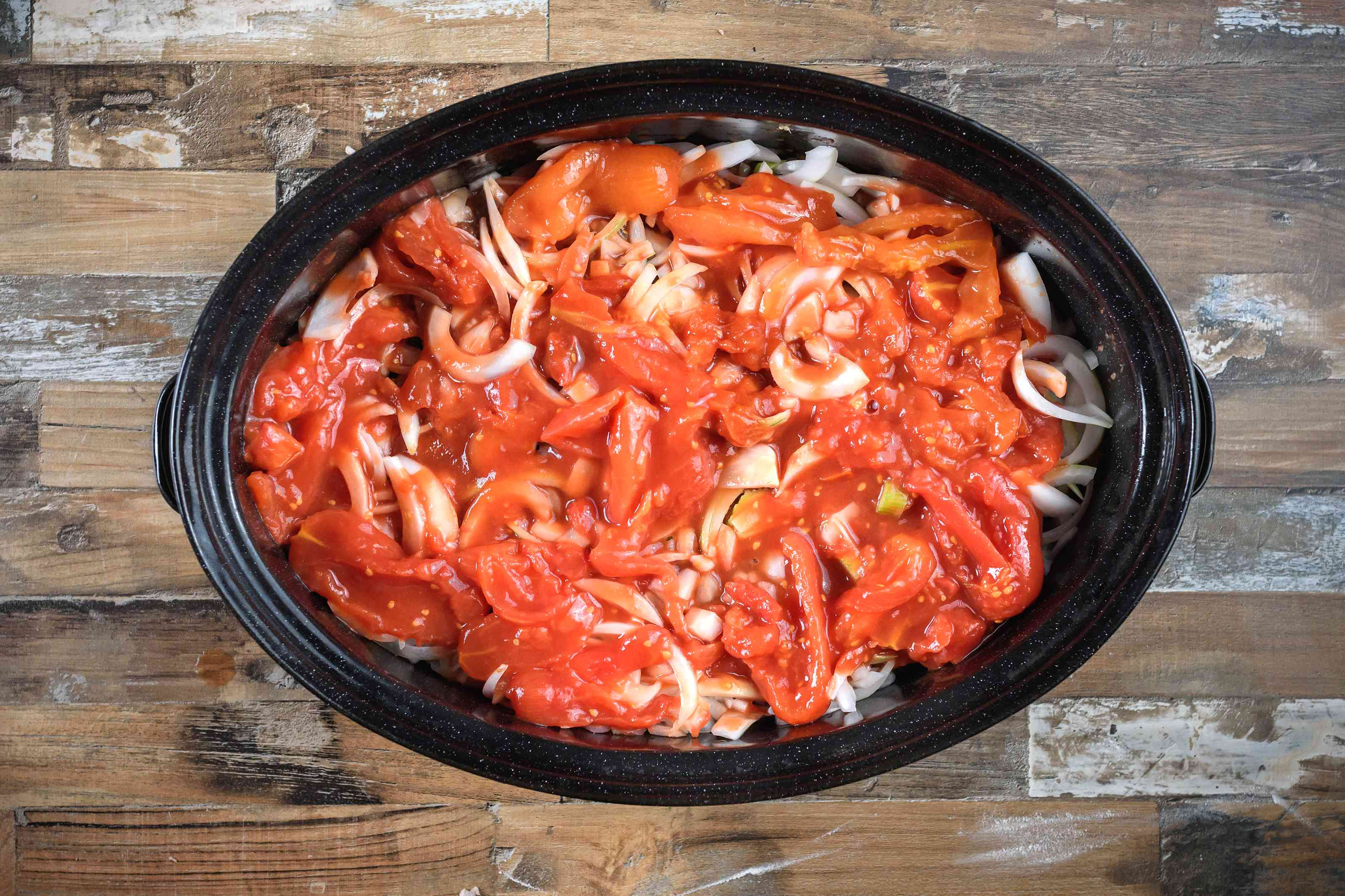 Steak, tomatoes, and onions in slow cooker