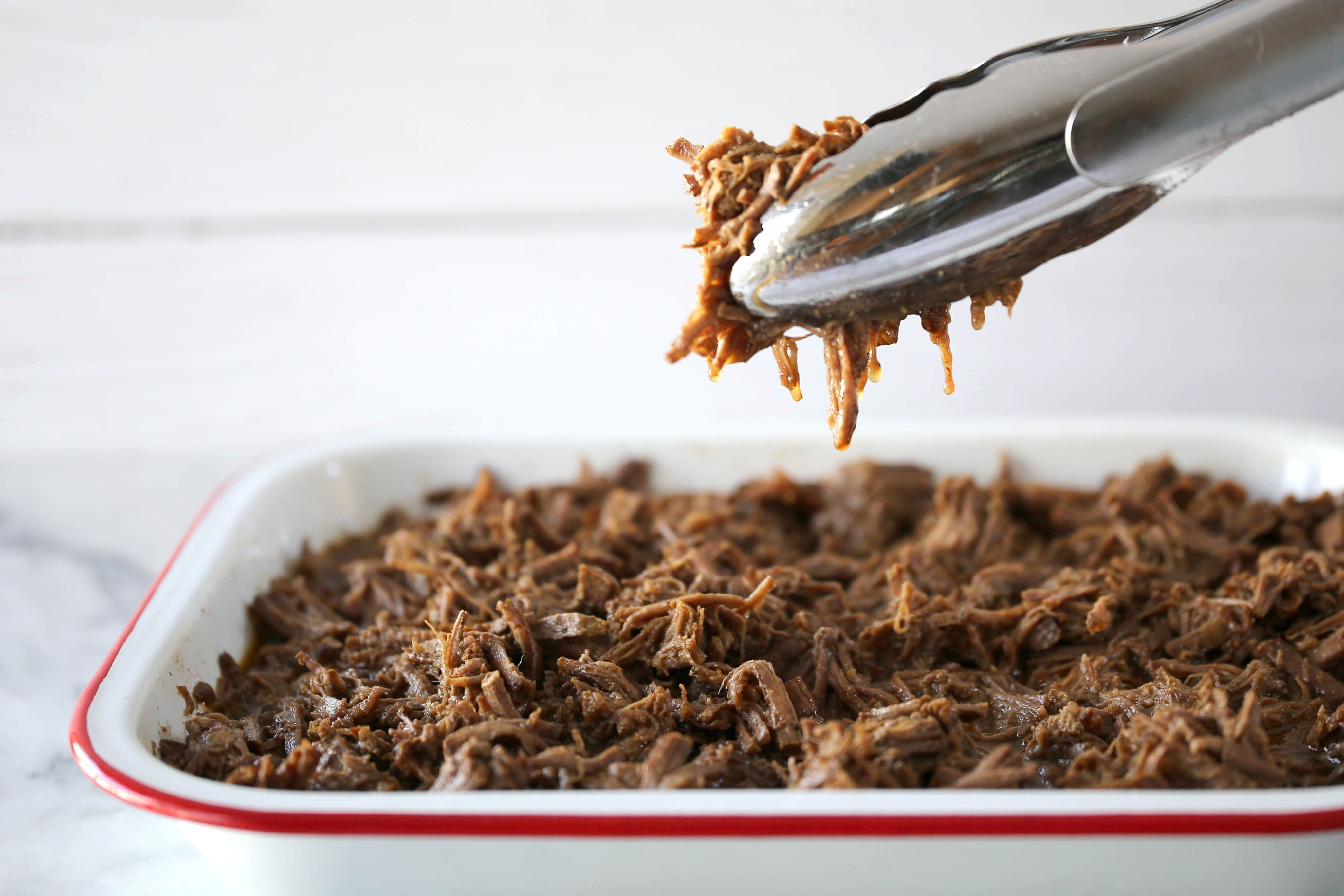 Shred the beef and mix it with the liquids.
