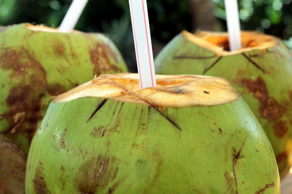 open coconut with straw