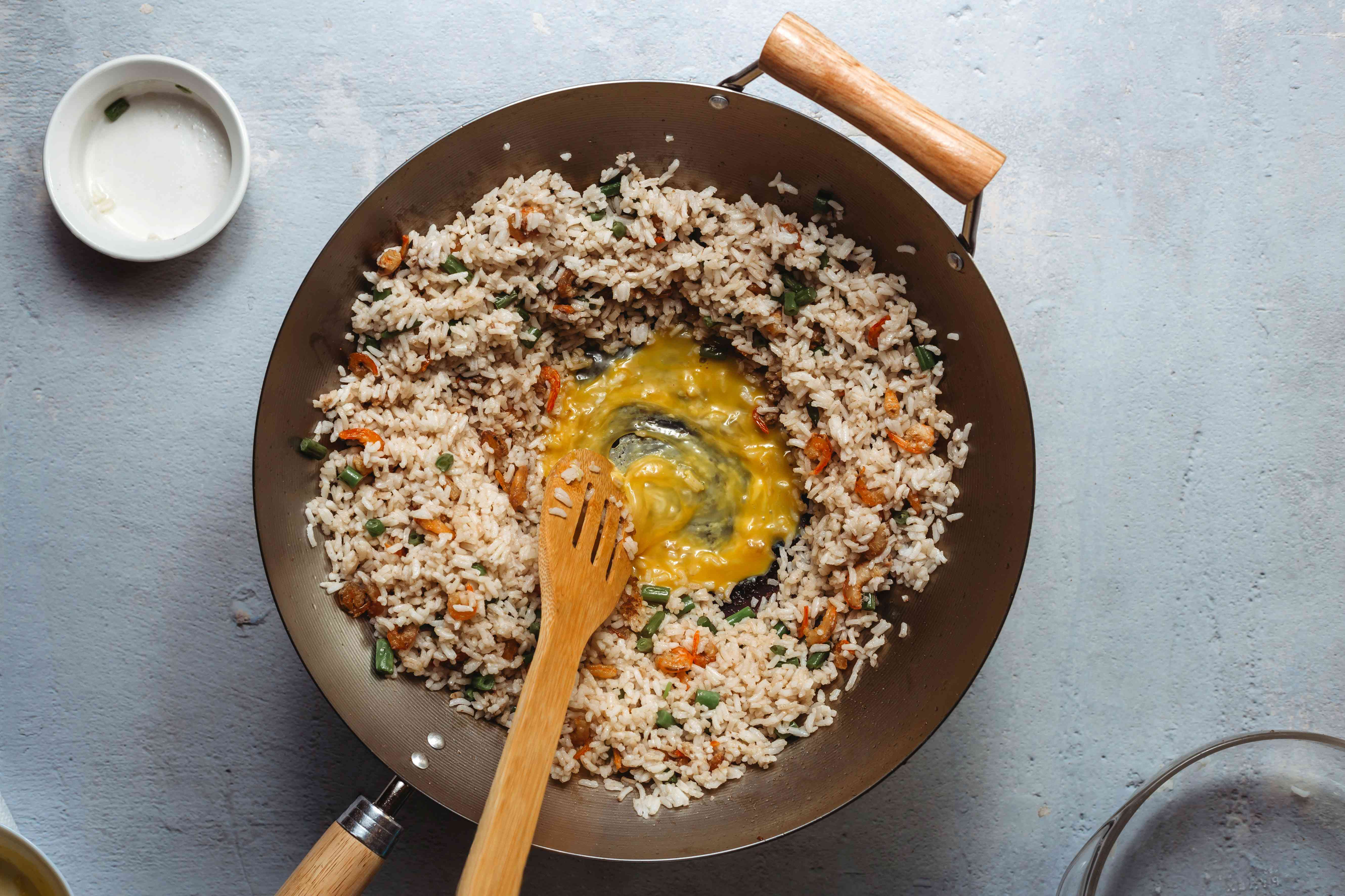 egg frying in the middle of the rice